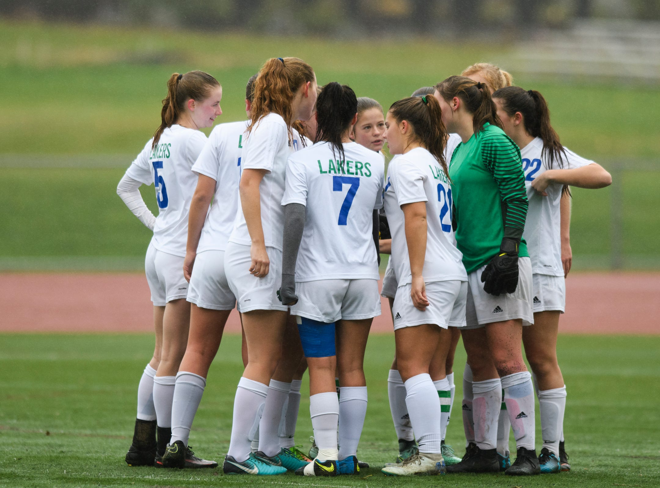 Colchester huddles together during the division I girls soccer championship game between the Colchester Lakers and the Champlain Valley Union Redhawks at Buck Hard Field on Saturday morning November 3, 2018 in Burlington.