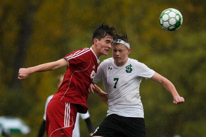 CVU's Nathaniel Sampson (17) and St. Johnsbury's Konrad Tillman (7) battle to head the ball during the Division I boys soccer championship game between the St. Johnsbury Hilltoppers and the Champlain Valley Union Redhawks at Buck Hard Field on Saturday morning November 3, 2018 in Burlington.