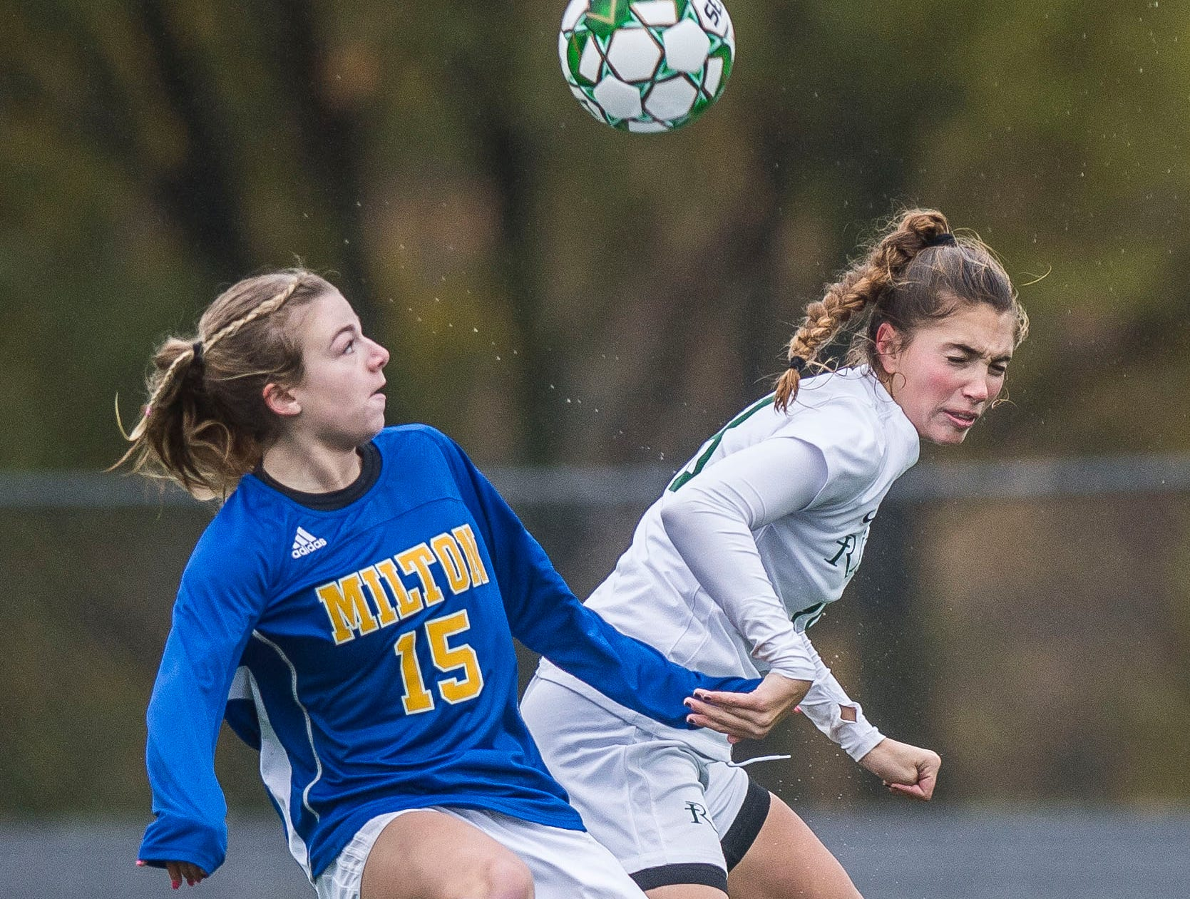 Milton #15 Emma Wennar collides with Rice #18 Abby Mckeown during the Div. 2 Vermont State girl's high school soccer championship on Saturday, Nov. 3, 2018, at South Burlington High School. Milton won the championship in sudden-death overtime, 2-1.