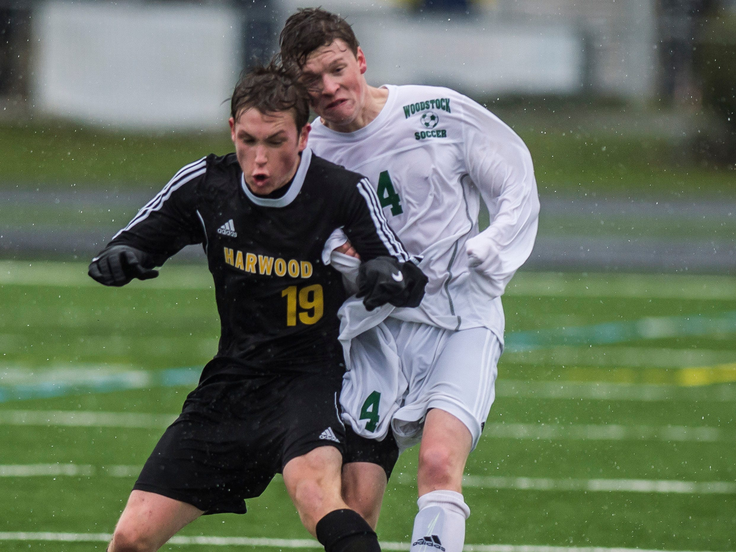Hardwood #19 Duncan Weinman fights for the ball against Woodstock #4 Mason Harkins during their Div. 2 Vermont State high school boy's soccer championship game at South Burlington High School on Saturday, Nov. 3, 2018. Hardwood Union won, 3-0.