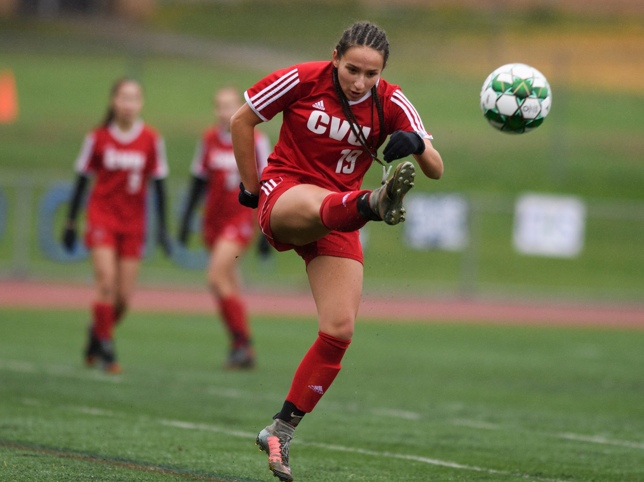 CVU's Sara Kelley (19) plays the ball during the division I girls soccer championship game between the Colchester Lakers and the Champlain Valley Union Redhawks at Buck Hard Field on Saturday morning November 3, 2018 in Burlington.