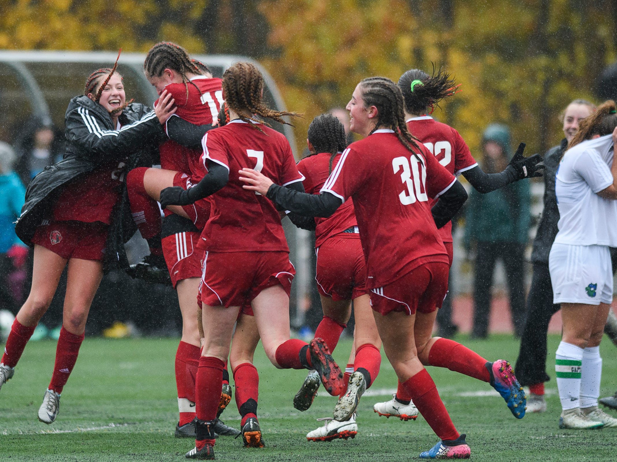 CVU celebrates the championship at the conclusion of the division I girls soccer championship game between the Colchester Lakers and the Champlain Valley Union Redhawks at Buck Hard Field on Saturday morning November 3, 2018 in Burlington.