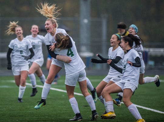Rice #9 Alex Dostie celebrates her goal with teammates during the Div. 2 Vermont State girl's high school soccer championship on Saturday, Nov. 3, 2018, at South Burlington High School. Milton won the championship in sudden-death overtime, 2-1.