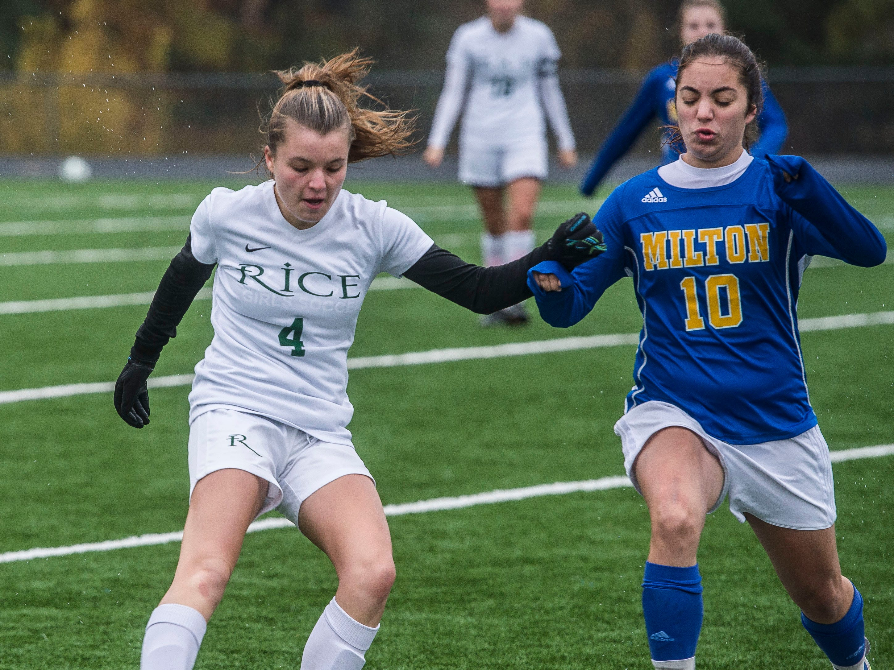 Rice #4 Emma Blanck fights off Milton #10 Samantha Orest during the Div. 2 Vermont State girl's high school soccer championship on Saturday, Nov. 3, 2018, at South Burlington High School. Milton won the championship in sudden-death overtime, 2-1.