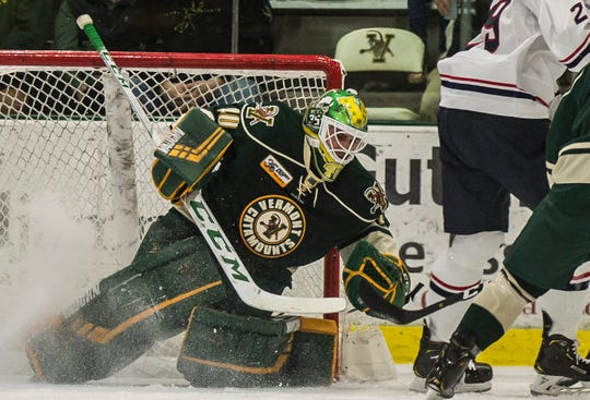 UVM goalie Stefanos Lekkas deflects a fly by goal attempt from Uconn during their hockey game Friday night, Nov. 2, 2018, at home. The Huskies pulled out a win, 1-0.
