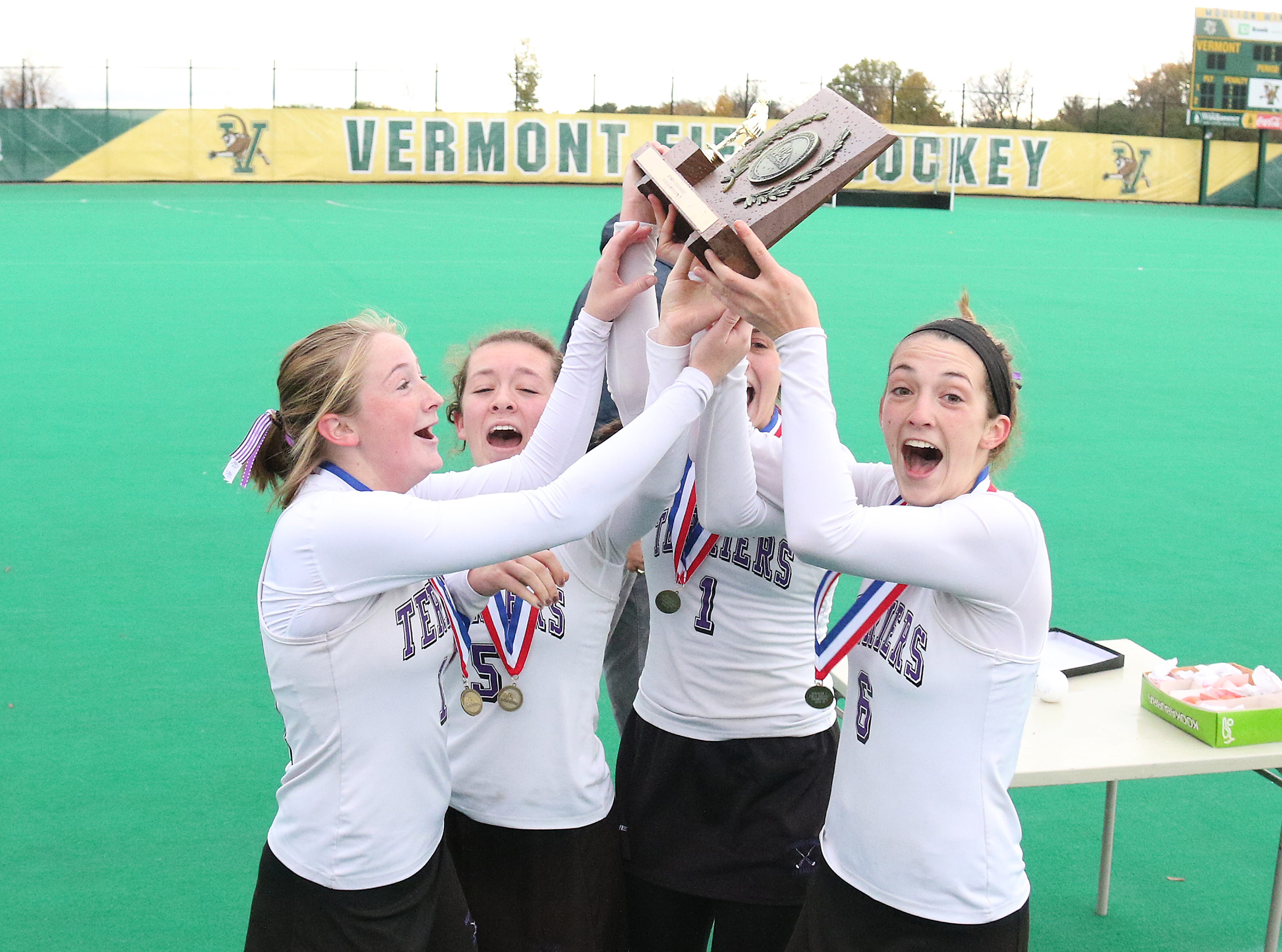 The Bellows Falls seniors bring the D1 trophy home to their teamates after defeating South Burlington 2-0 on Saturday at UVM.