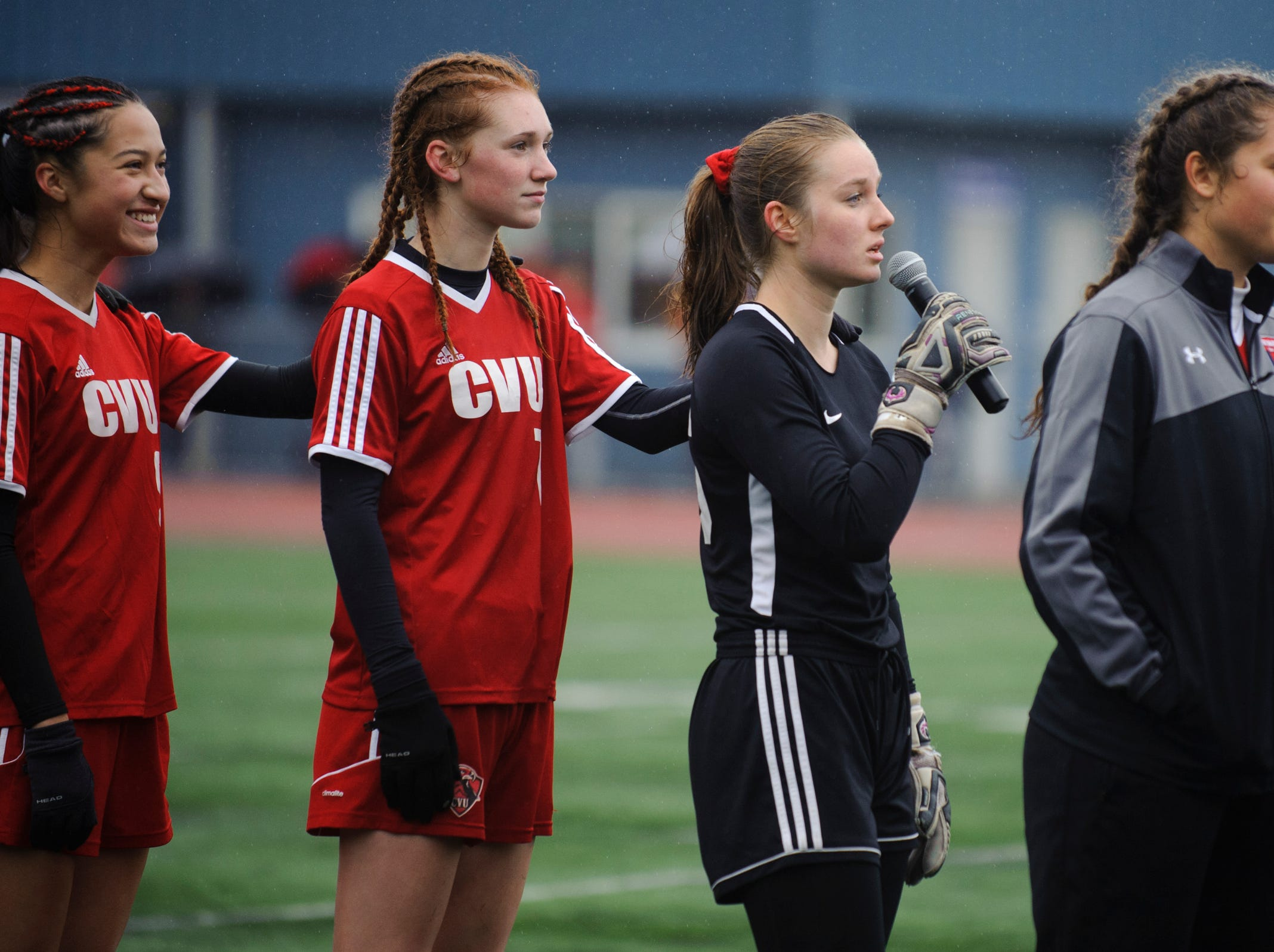 CVU goalie Maryn Askew sings the National Anthem during the division I girls soccer championship game between the Colchester Lakers and the Champlain Valley Union Redhawks at Buck Hard Field on Saturday morning November 3, 2018 in Burlington.