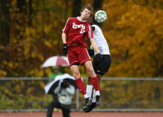 CVU's Erik Stolen (13) leaps to head the ball during the Division I boys soccer championship game between the St. Johnsbury Hilltoppers and the Champlain Valley Union Redhawks at Buck Hard Field on Saturday morning November 3, 2018 in Burlington.