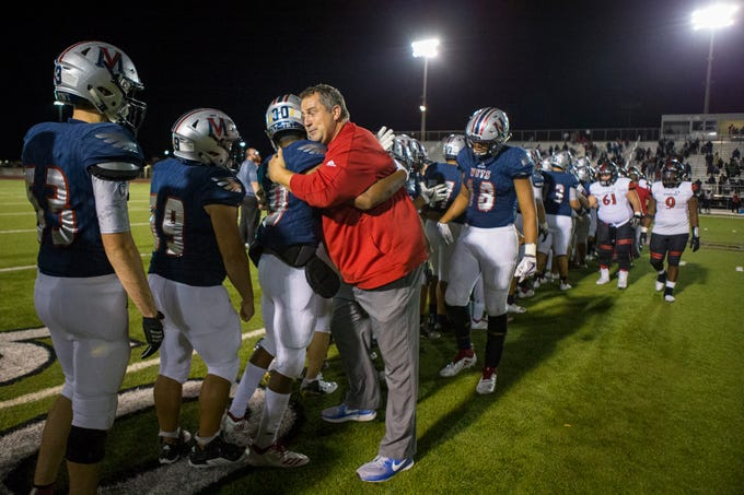 Veterans Memorial Defensive Coordinator Scott Hawks hugs players following the team's win over Victoria West at Cabaniss Field on Friday, November 2, 2018. The win also clinched the District title for Veterans Memorial.