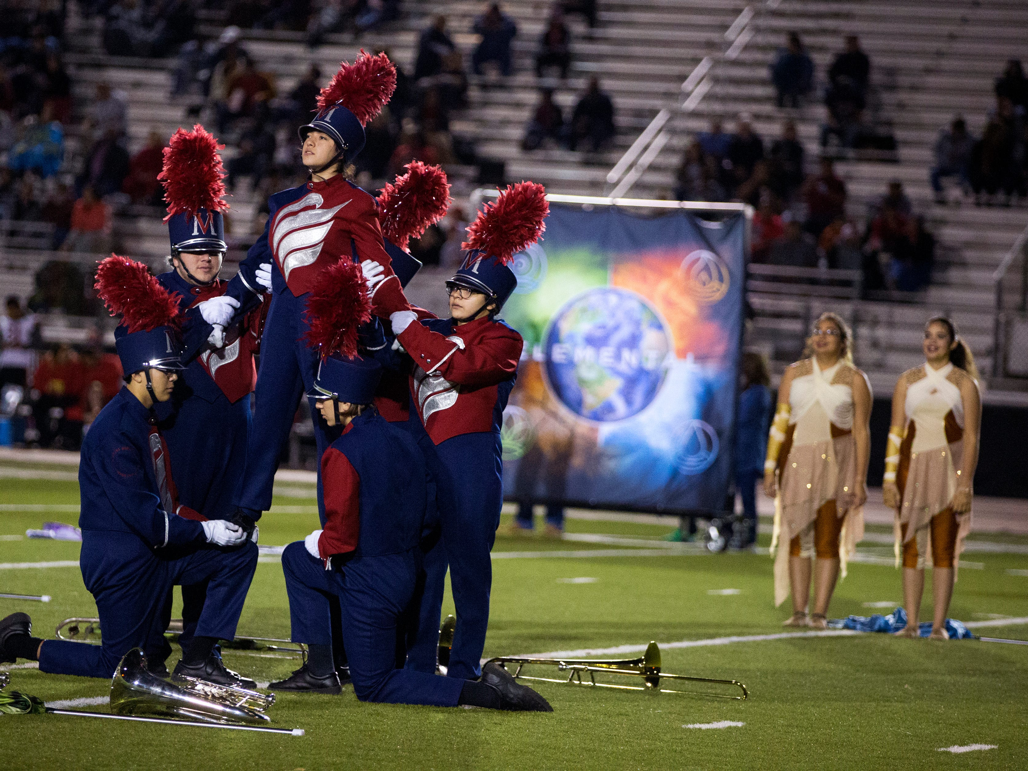 Members of the Veterans Memorial High School Screaming Eagle Band preform during halftime of the Veterans Memorial and Victoria West football game at Cabaniss Field on Friday, November 2, 2018.