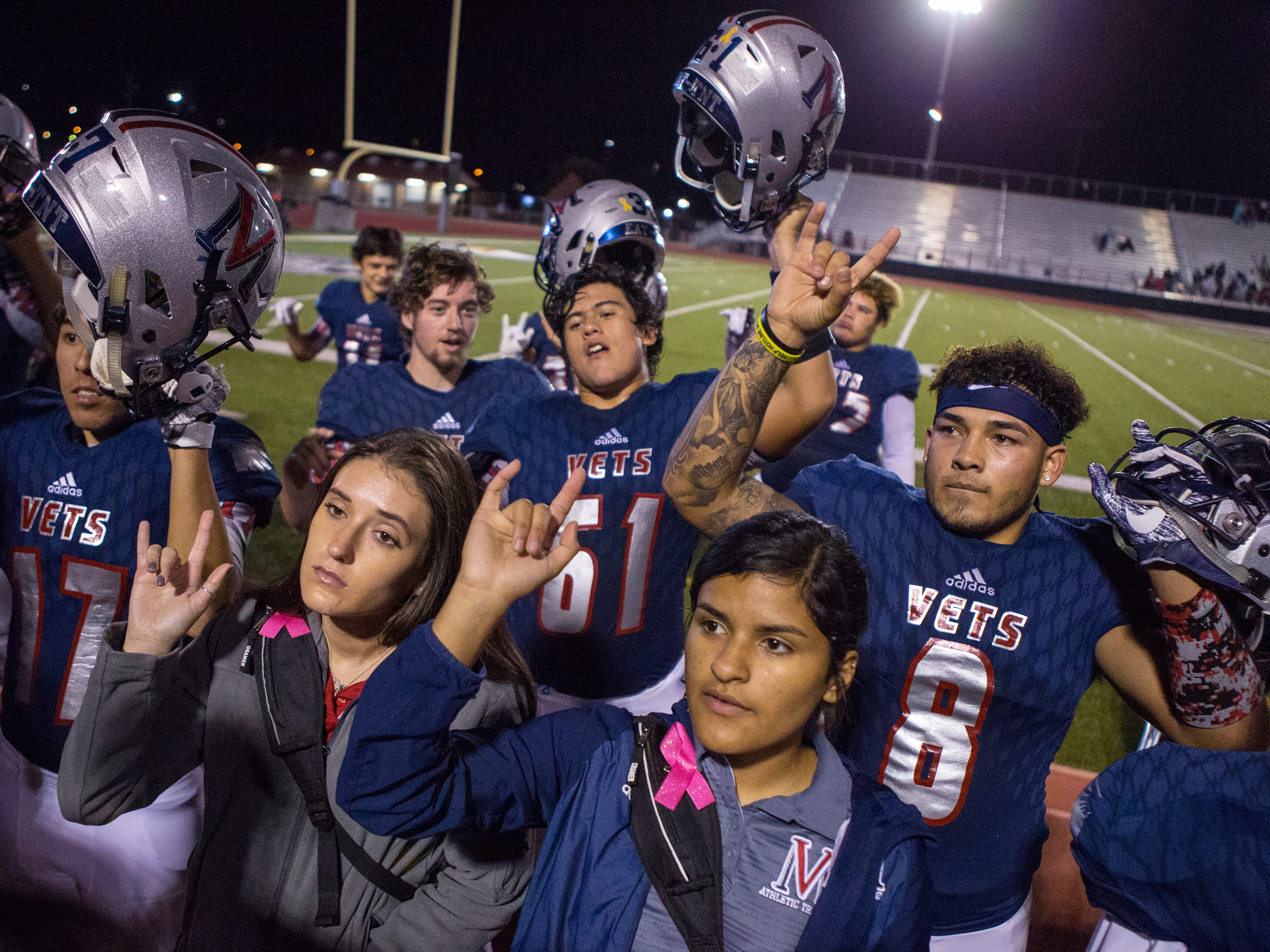 Veterans Memorial's David Soto (back right) stands as the school song is played after the team won over Victoria West at Cabaniss Field on Friday, November 2, 2018. The win also clinched the District title for Veterans Memorial.