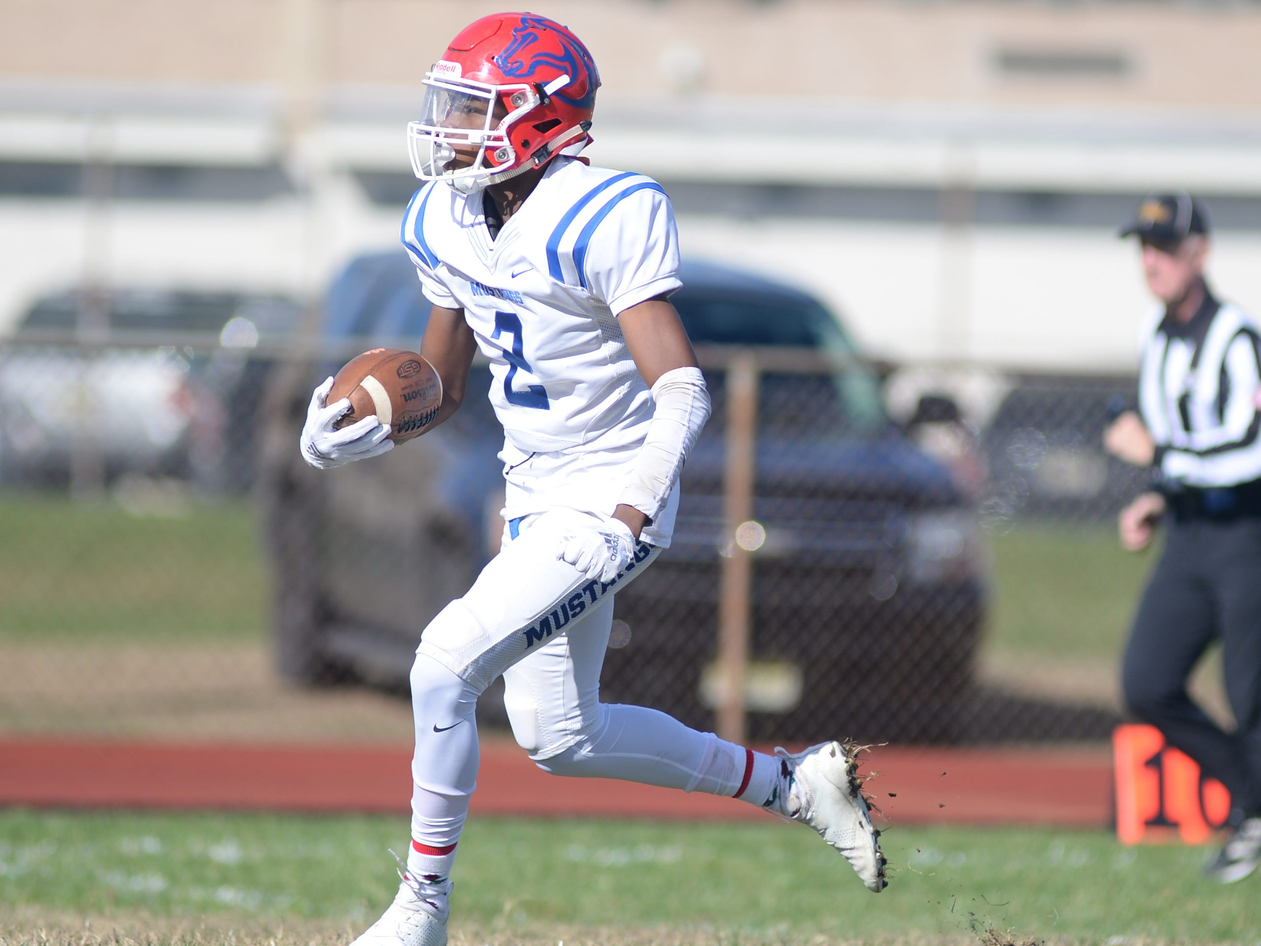 Triton's Shawn Coleman returns a kick against Woodrow Wilson during Saturday's South Jersey Group 3 first round game at Woodrow Wilson High School, Nov. 3, 2018.