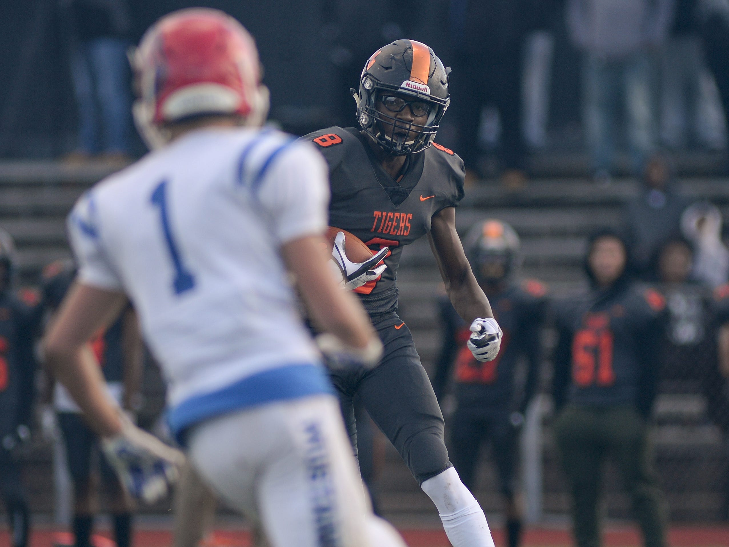 Woodrow Wilson's Stanley King runs the ball after making a reception during Saturday's South Jersey Group 3 first round game against Triton at Woodrow Wilson High School, Nov. 3, 2018.