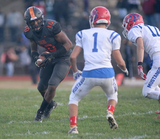 Woodrow Wilson's Fadil Diggs runs the ball after making a reception during Saturday's South Jersey Group 3 first round game against Triton at Woodrow Wilson High School, Nov. 3, 2018.