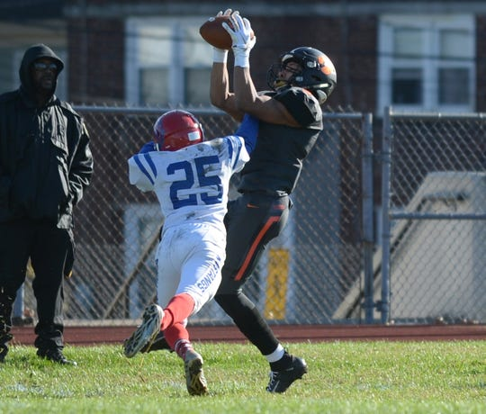 Woodrow Wilson's Naiem Simmons catches a pass during Saturday's South Jersey Group 3 first round game against Triton at Woodrow Wilson High School, Nov. 3, 2018.