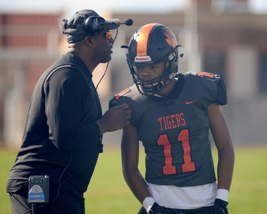 Woodrow Wilson's coach Preston Brown talks with Amari Clark during Saturday's South Jersey Group 3 first round game against Triton at Woodrow Wilson High School, Nov. 3, 2018.