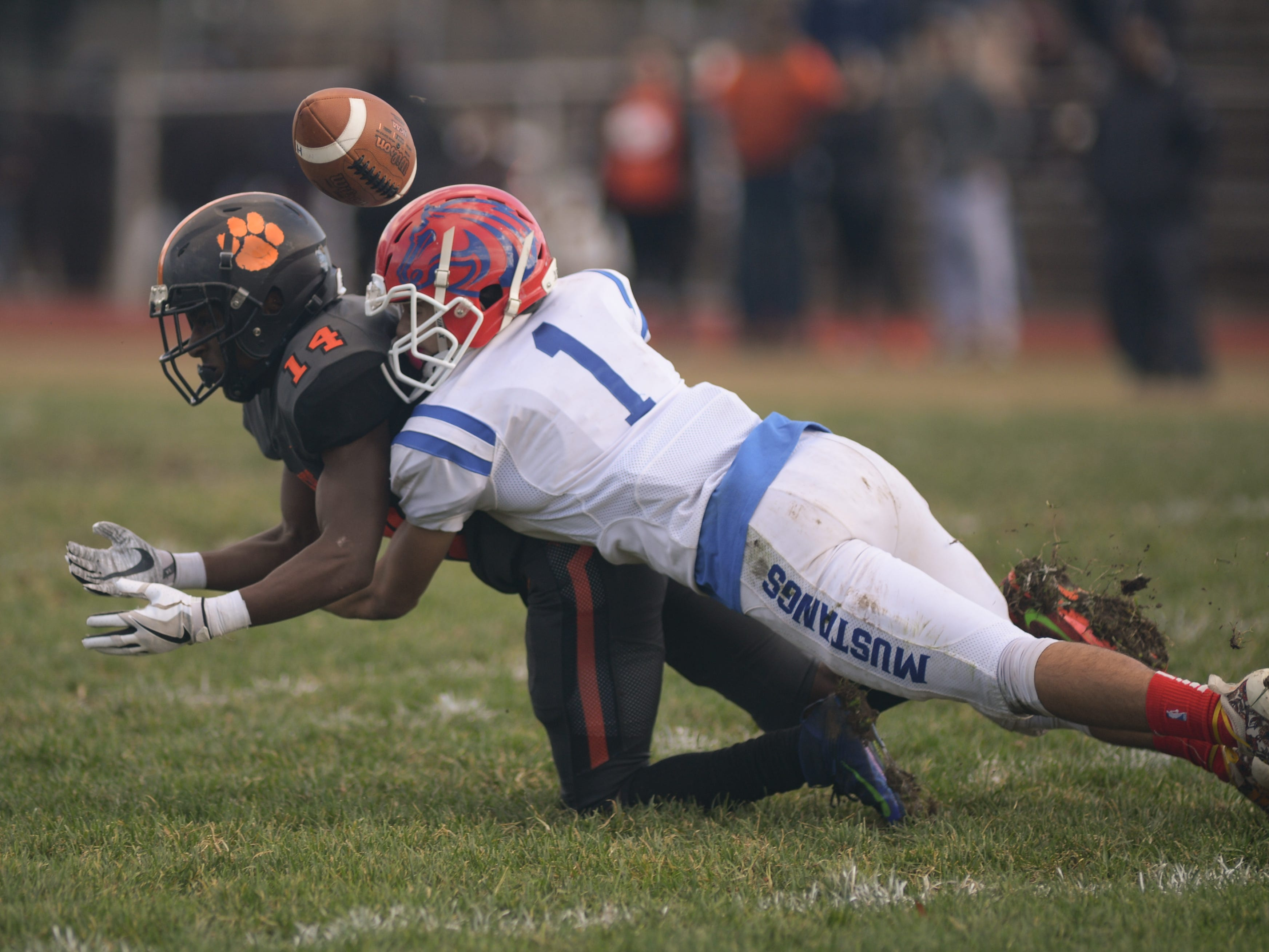 Triton's Joe Rubba breaks up a pass intended for Woodrow Wilson's Shyfula Corbin during Saturday's South Jersey Group 3 first round game at Woodrow Wilson High School, Nov. 3, 2018.