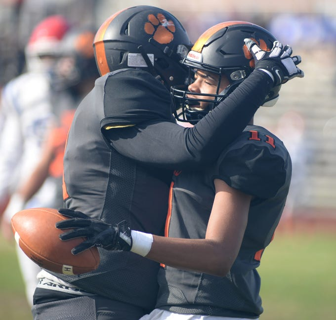 Woodrow Wilson's Amari Clark gets a hug from a teammate after catching a touchdown pass during Saturday's South Jersey Group 3 first round game against Triton at Woodrow Wilson High School, Nov. 3, 2018.