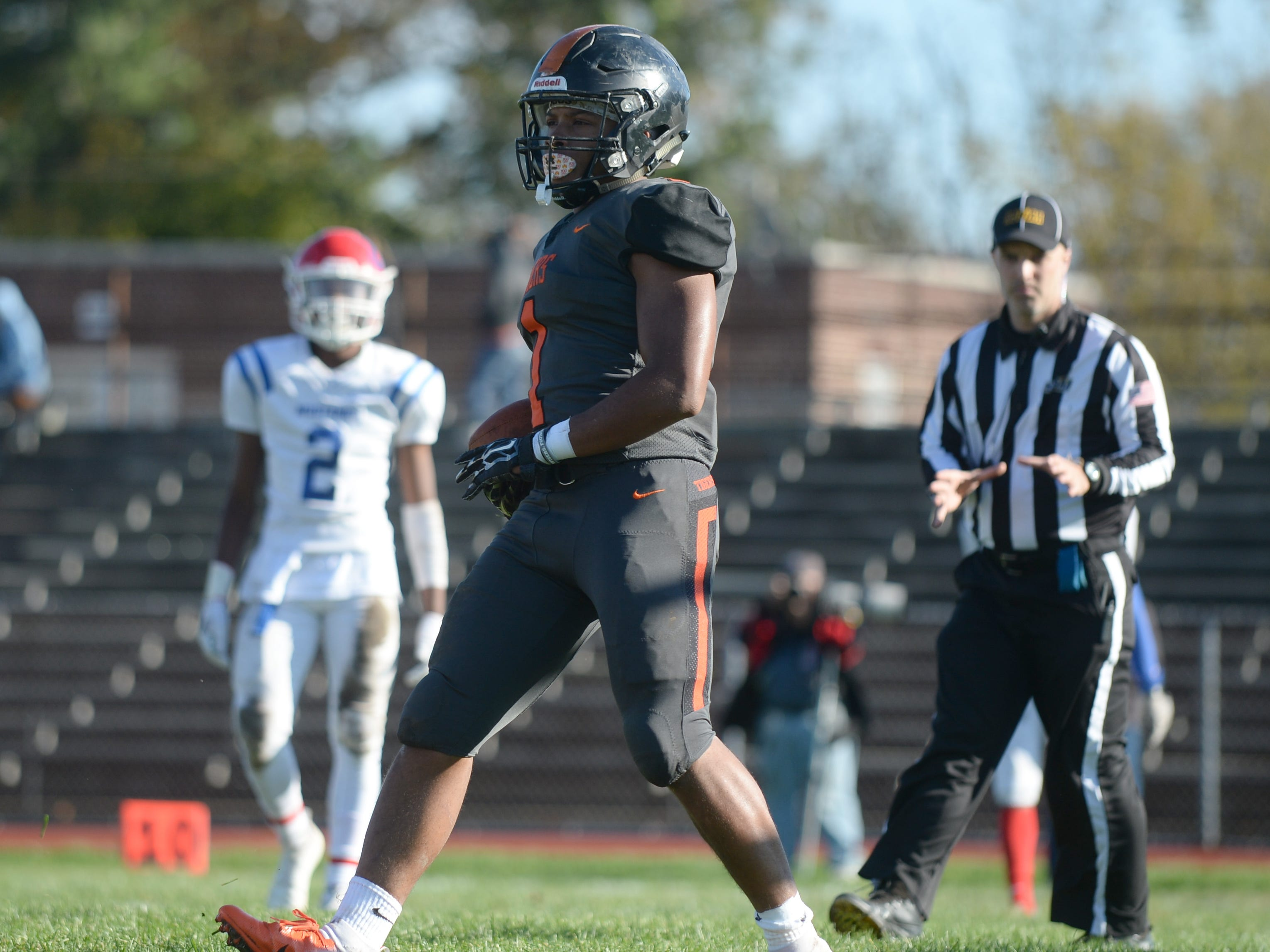 Woodrow Wilson's Muheem Mccargo reacts after carrying the ball for a touchdown during Saturday's South Jersey Group 3 first round game against Triton at Woodrow Wilson High School, Nov. 3, 2018.