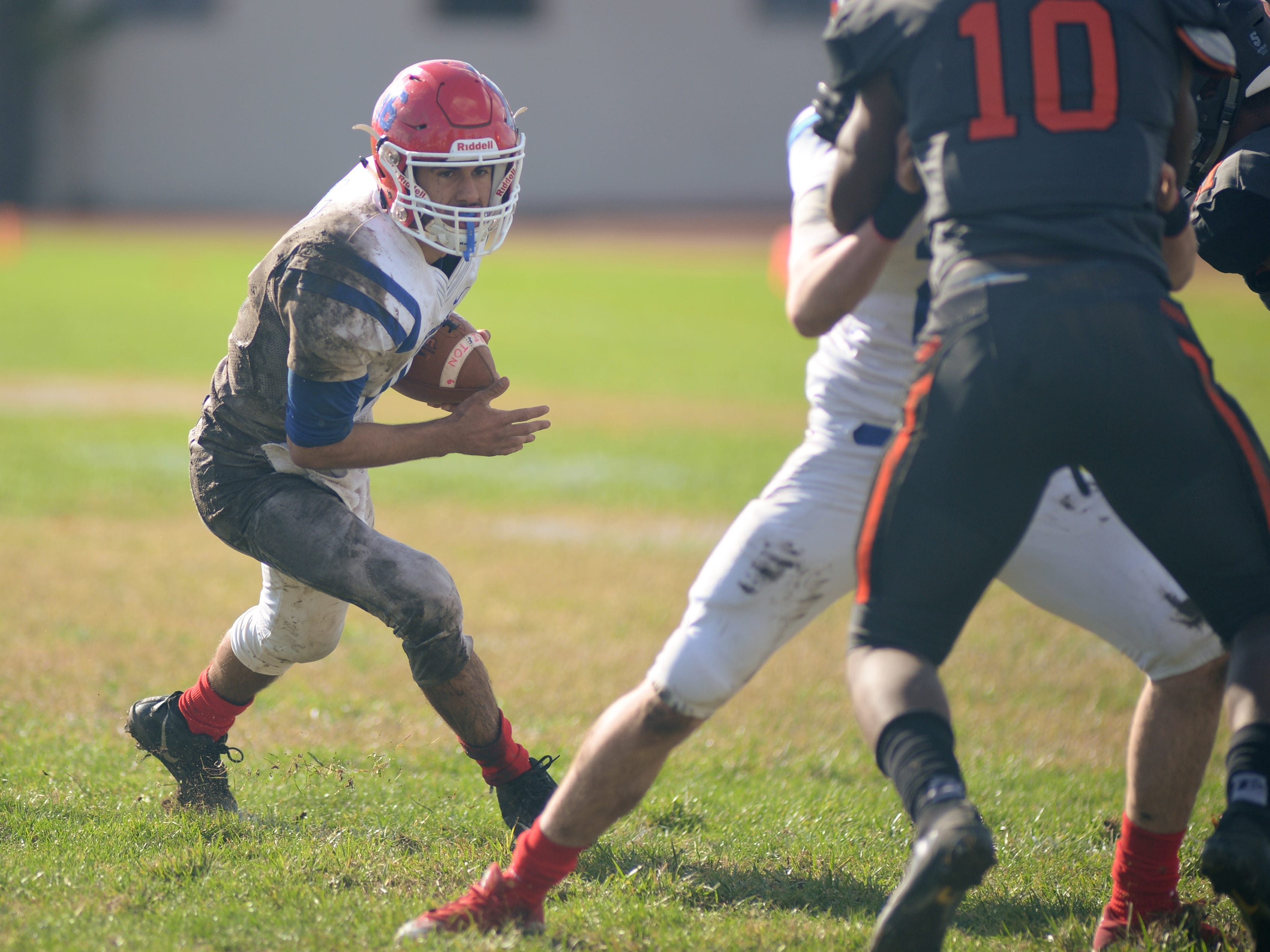 Triton's Geff Giancaterino carries the ball during Saturday's South Jersey Group 3 first round game against Woodrow Wilson, at Woodrow Wilson High School, Nov. 3, 2018.