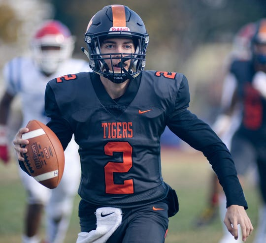 Woodrow Wilson quarterback Nick Kargman looks for an open receiver during Saturday's South Jersey Group 3 first round game against Triton at Woodrow Wilson High School, Nov. 3, 2018.