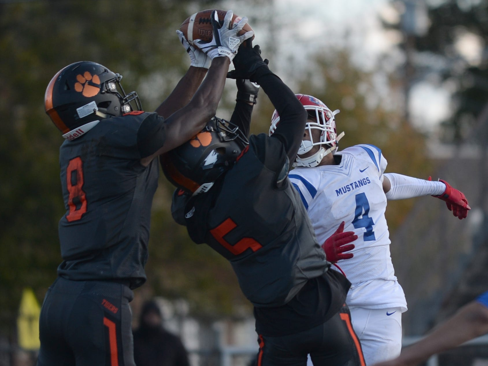Woodrow Wilson's Stanley King intercepts a Triton pass during Saturday's South Jersey Group 3 first round game at Woodrow Wilson High School, Nov. 3, 2018.