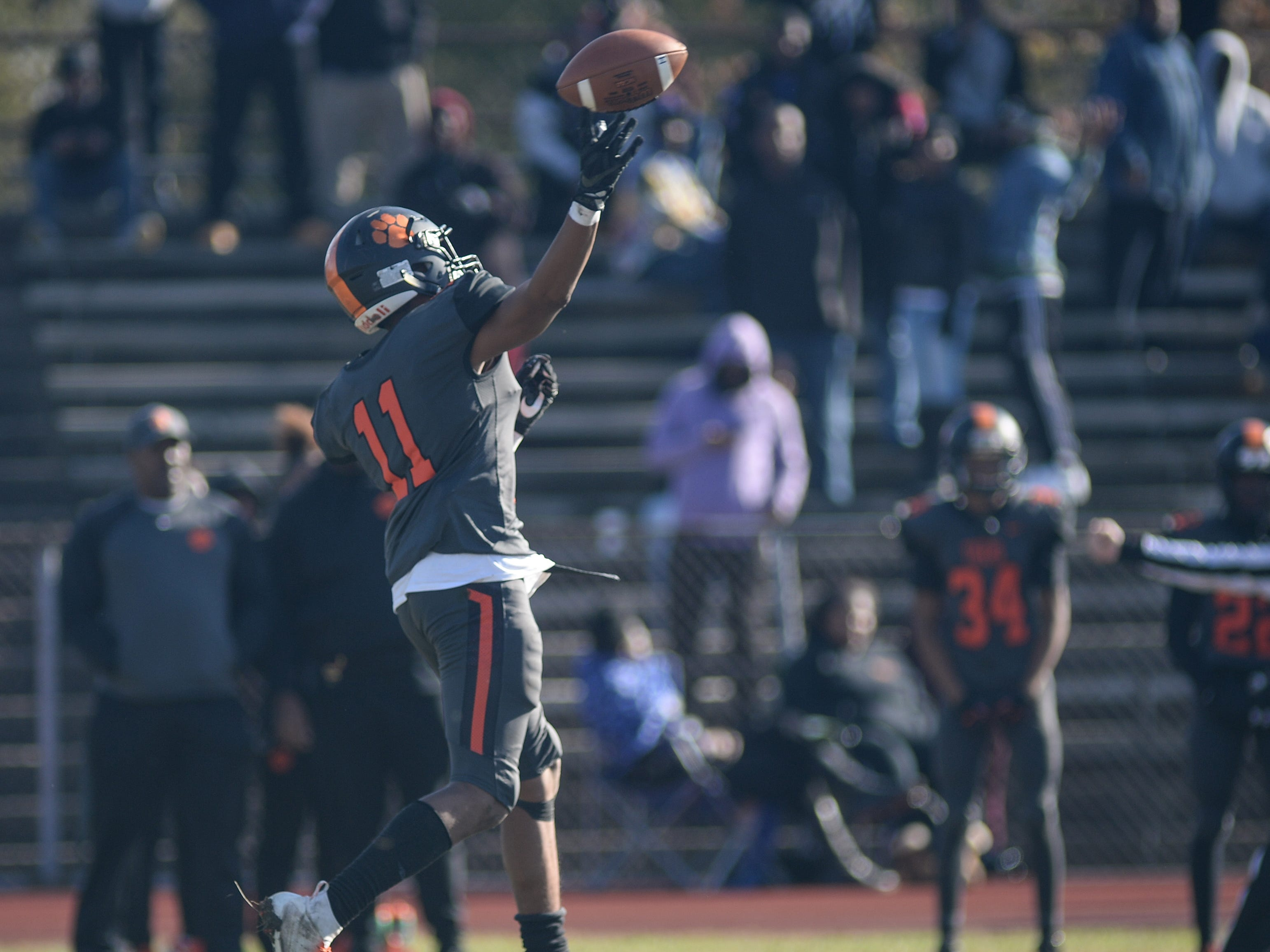 Woodrow Wilson's Amari Clark throws a pass during Saturday's South Jersey Group 3 first round game against Triton at Woodrow Wilson High School, Nov. 3, 2018.