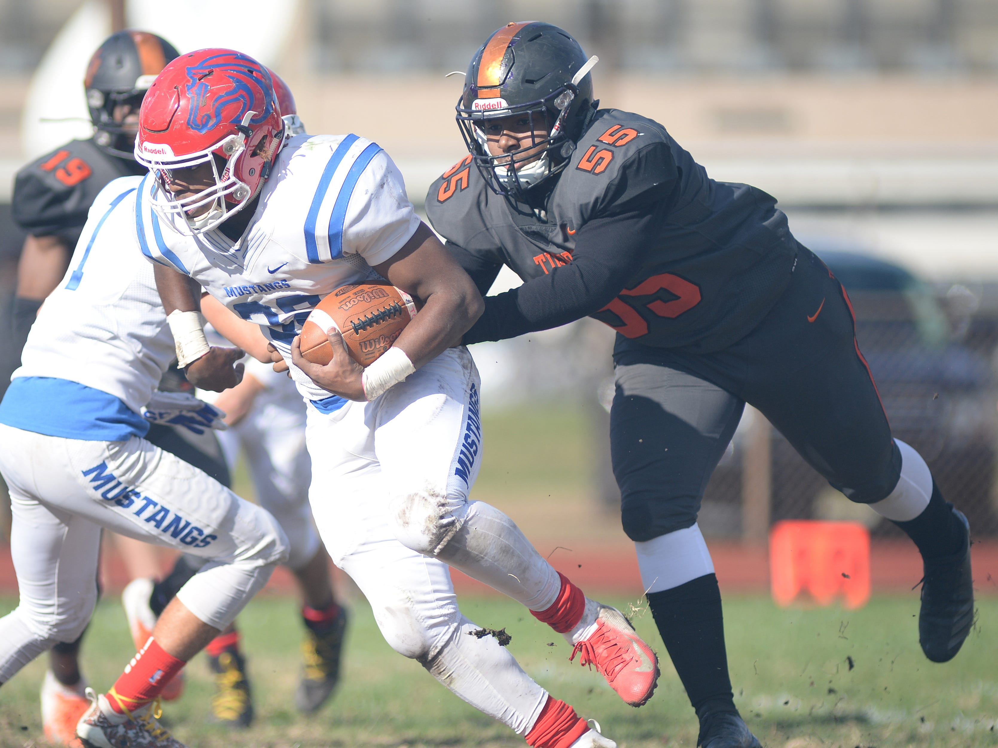 Triton's Eric Staton carries the ball against Woodrow Wilson during Saturday's South Jersey Group 3 first round game at Woodrow Wilson High School, Nov. 3, 2018.