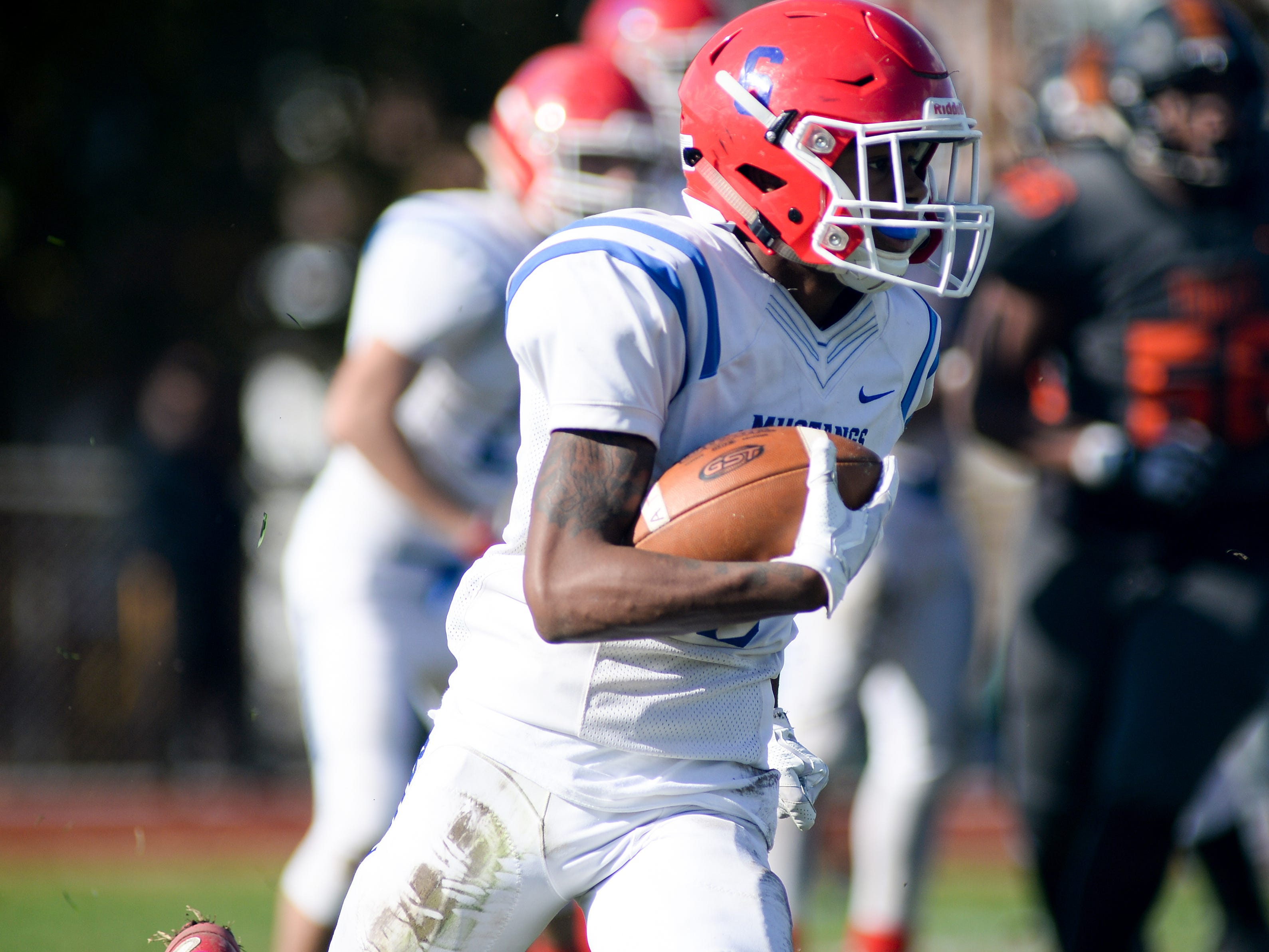Triton's Davaun Payton carries the ball against Woodrow Wilson during Saturday's South Jersey Group 3 first round game at Woodrow Wilson High School, Nov. 3, 2018.