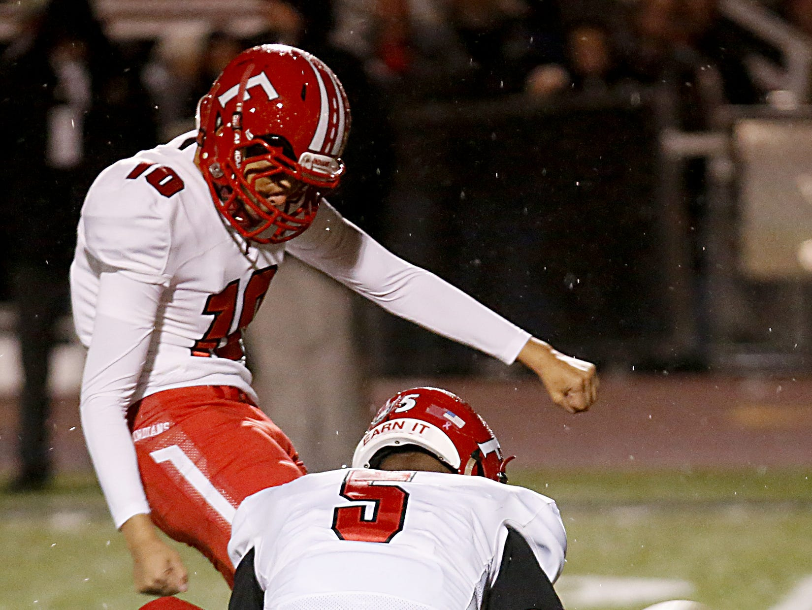 Fairfield kicker Elgin Phillips adds the PAT against Milford as Jeff Tyus holds during their Division I playoff game at Eagle Stadium in Milford Friday, Nov. 2, 2018.