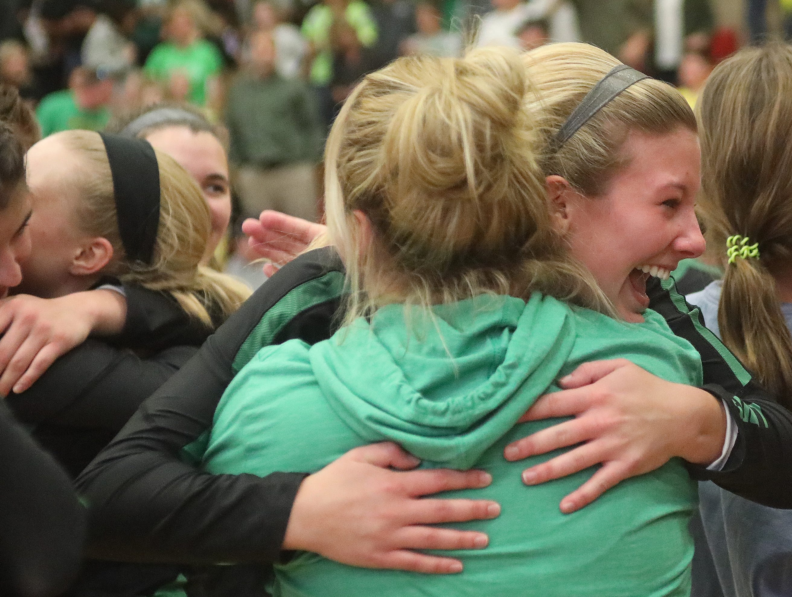 Ursuline players and coaches celebrate after the Lions win the regional championship, Saturday, Nov. 3,2018.