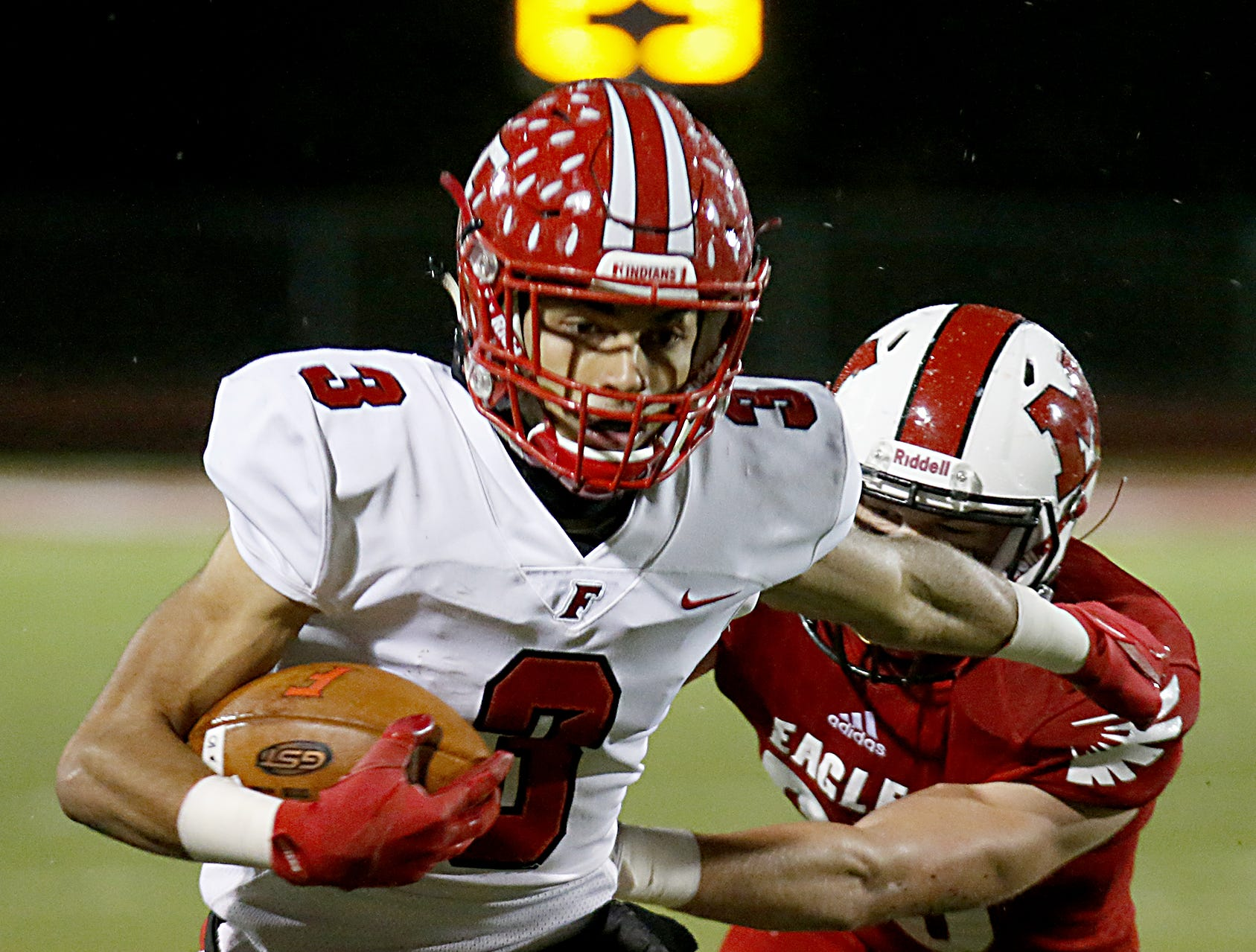 Fairfield wide receiver Peyton Brown escapes Milford defensive back Jared Engelman and runs for a touchdown during their Division I playoff game at Eagle Stadium in Milford Friday, Nov. 2, 2018.
