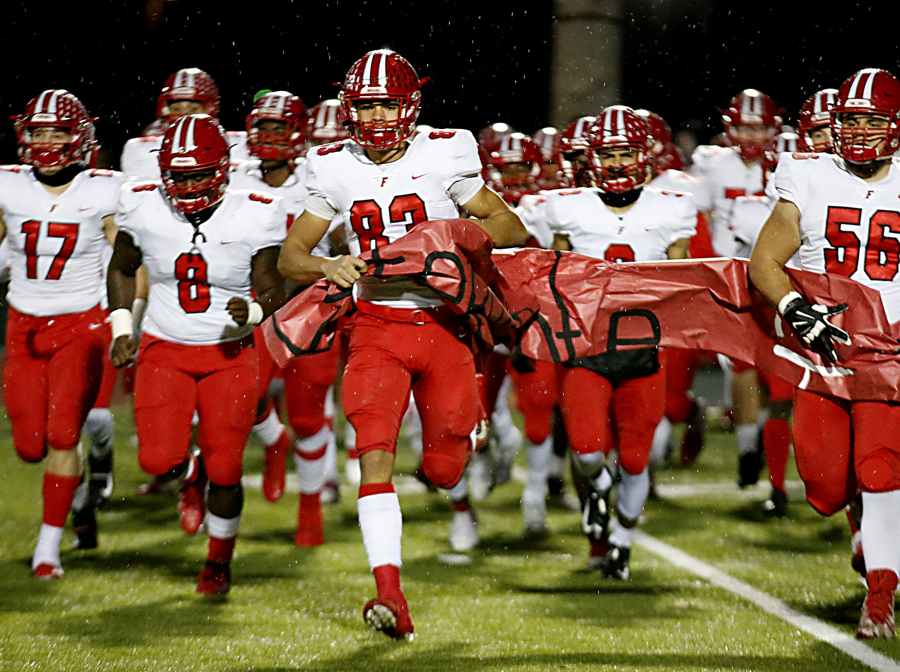 The Fairfield Indians take the field for their Division I playoff game against Milford at Eagle Stadium in Milford Friday, Nov. 2, 2018.