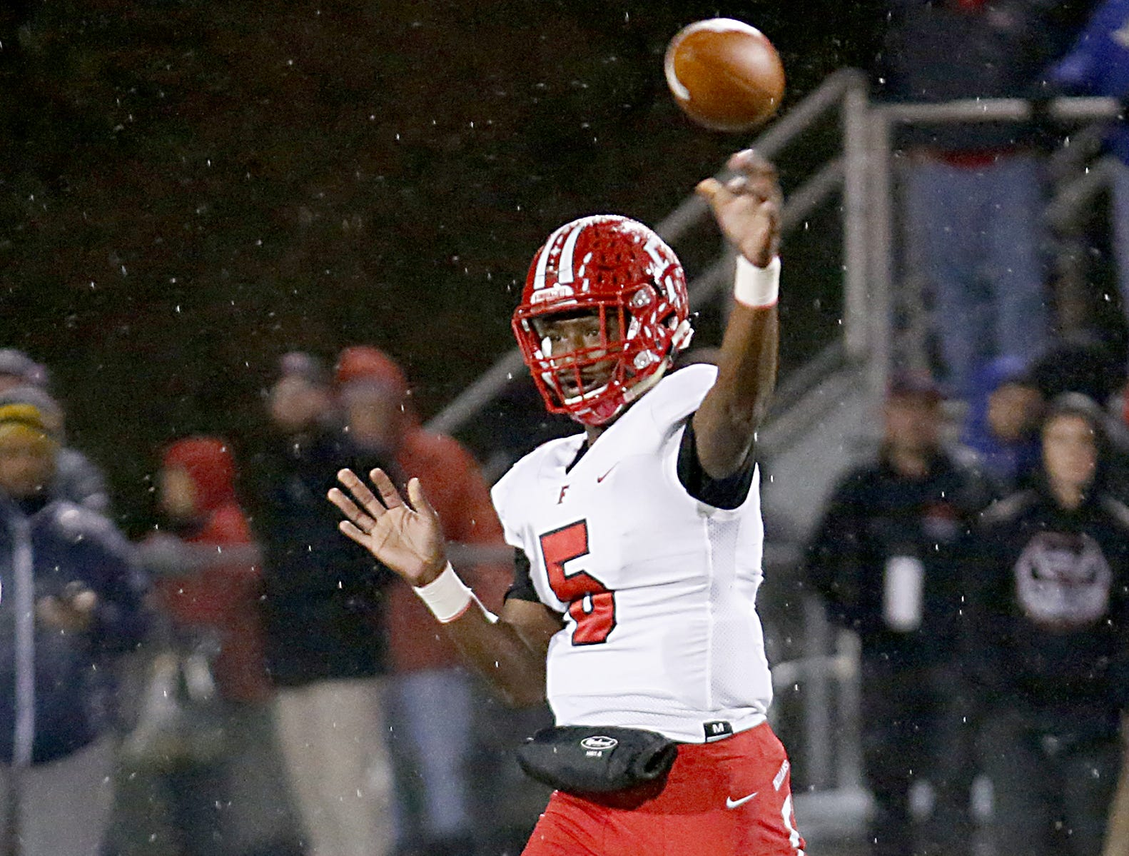 Fairfield quarterback Jeff Tyus passes against Milford during their Division I playoff game at Eagle Stadium in Milford Friday, Nov. 2, 2018.