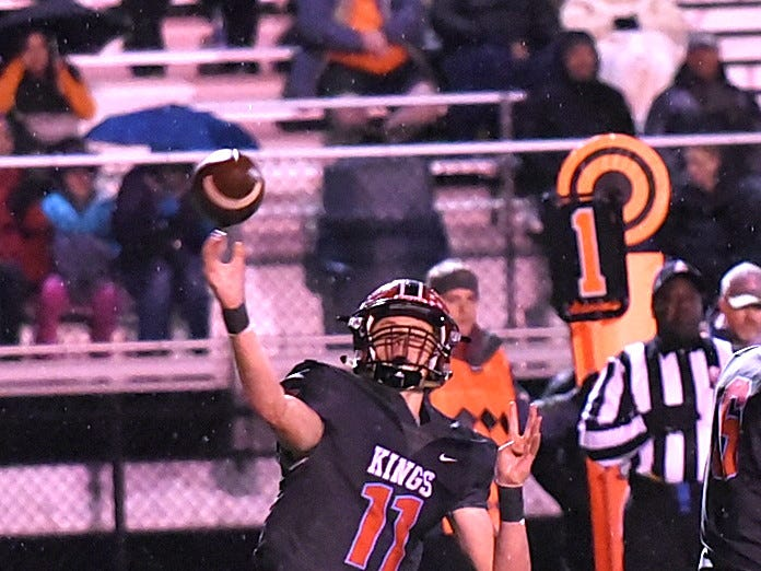 Kings quarterback Ashton Koller completes a short pass for the Knights in the Division 2 Region quarterfinal playoff game, November 2, 2018.