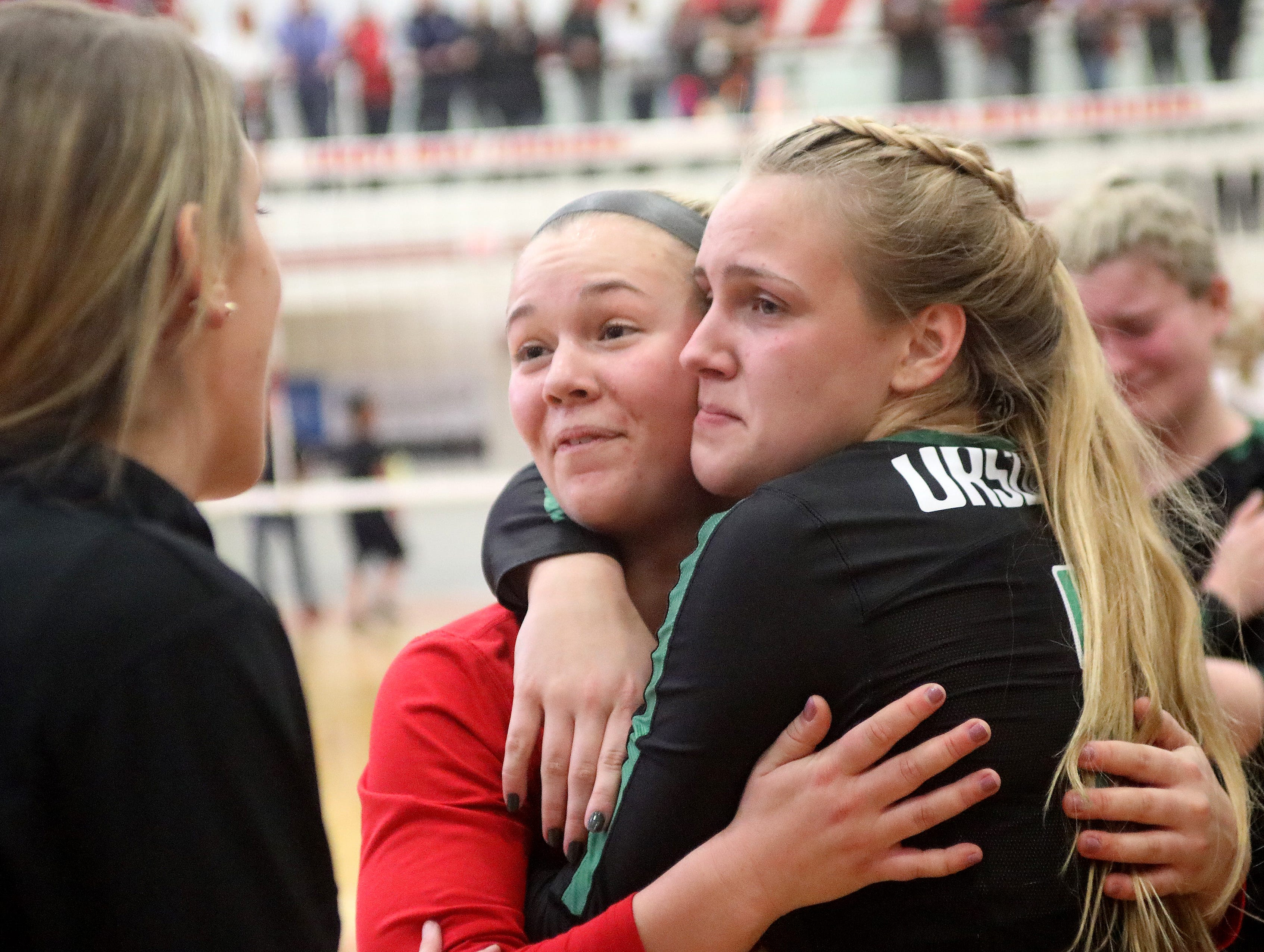Ursuline players Sydney McCarthy and Maggie Huber celebrate after the Lions win the regional championship, Saturday, Nov. 3,2018.