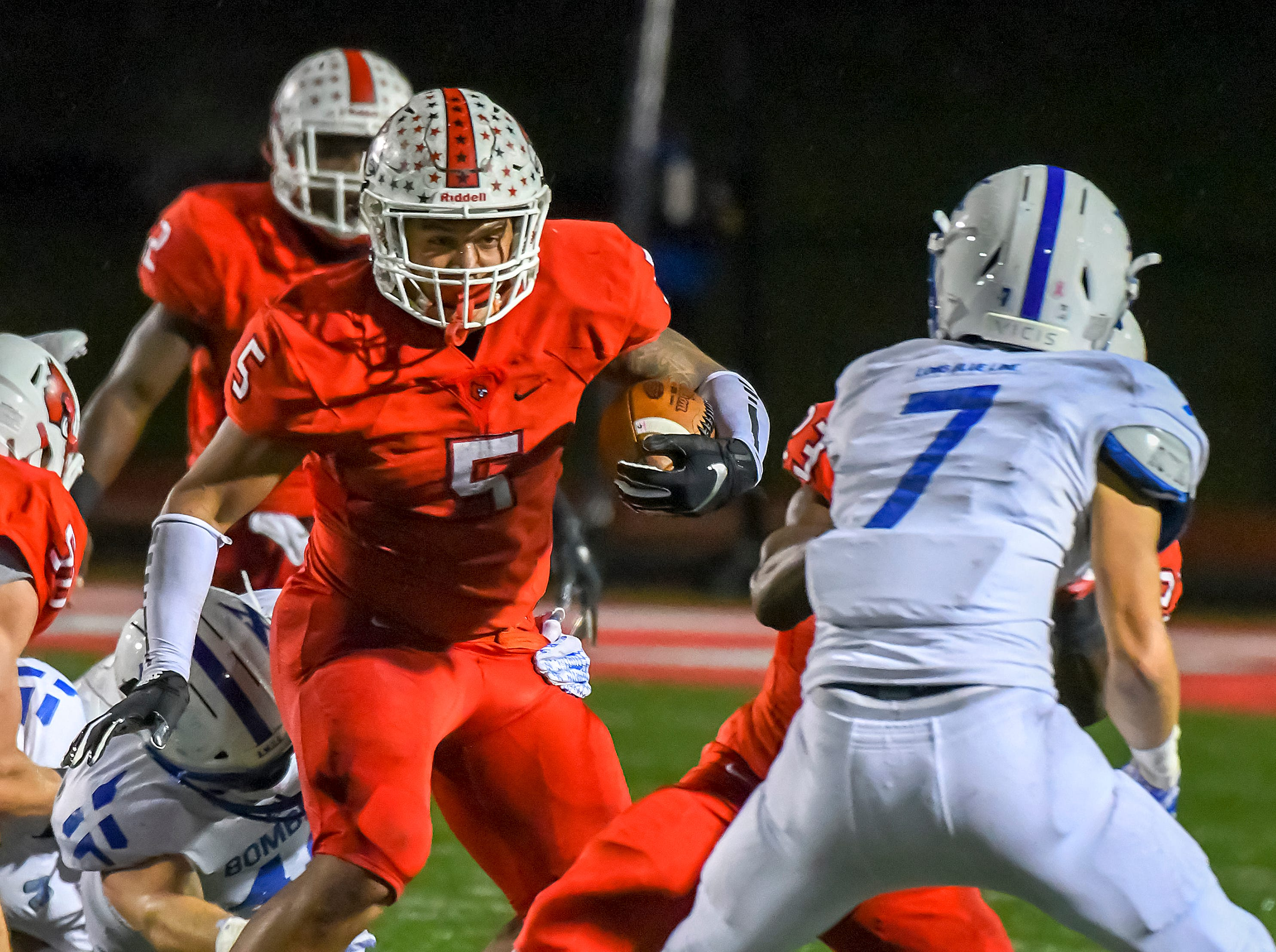 Ivan Pace Jr. (5) of Colerain runs the ball against St. X in the OHSAA DI Region 4 Playoffs at Colerain High School,  Friday Nov. 2, 2018