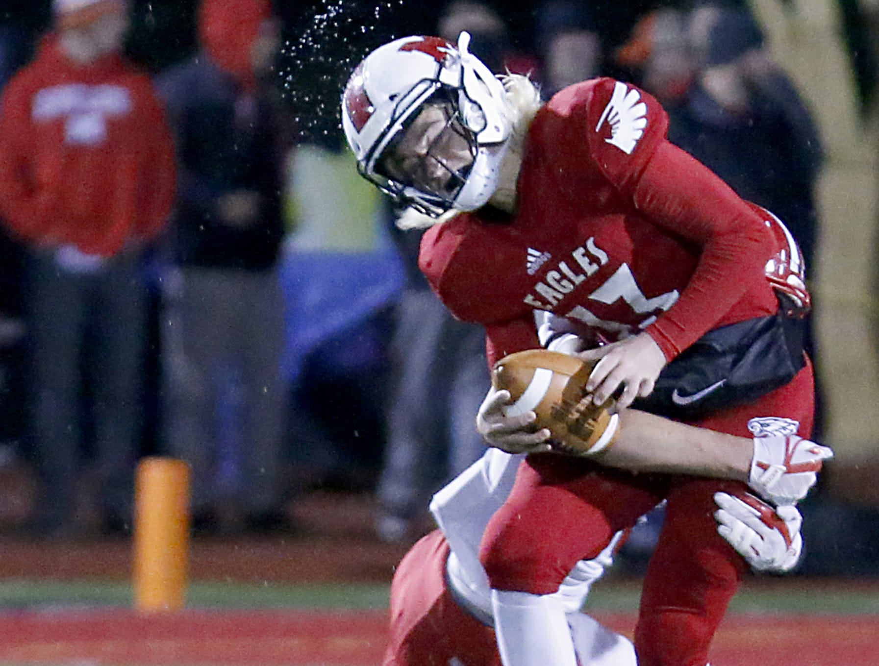 Milford quarterback Hunter Johnson is sacked by Fairfield's Erick All during their Division I playoff game at Eagle Stadium in Milford Friday, Nov. 2, 2018.