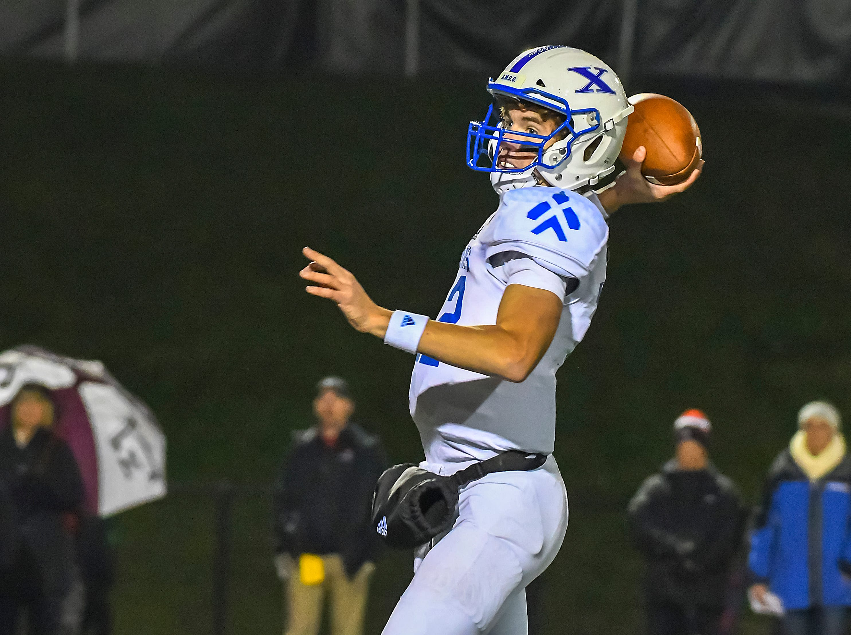 St. X quarterback Matthew Rueve attempts a pass against Colerain in the OHSAA DI Region 4 Playoffs at Colerain High School,  Friday Nov. 2, 2018