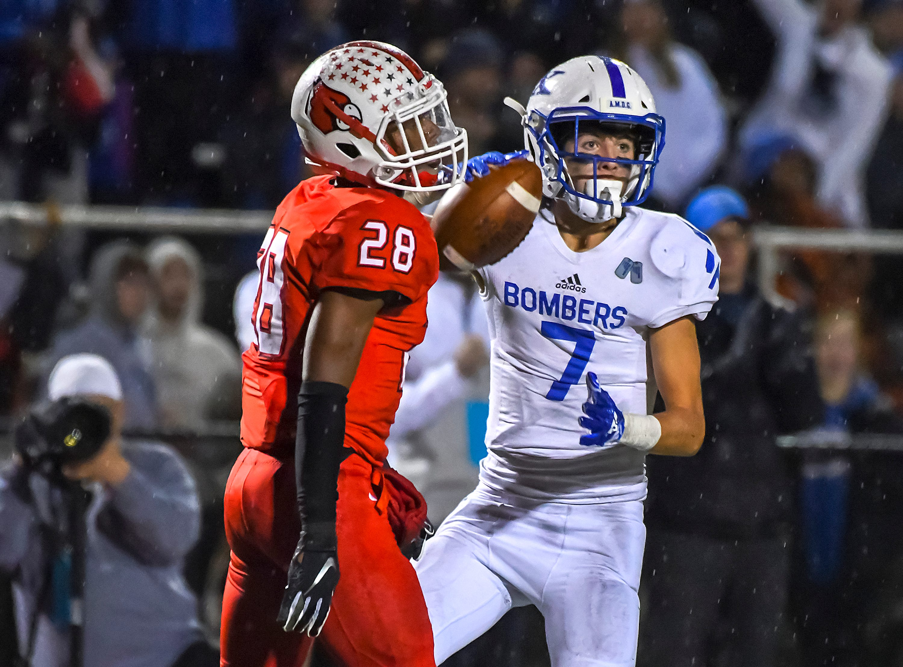 St. X defender Wiles Dolle (7) comes up with a interception against Colerain in the OHSAA DI Region 4 Playoffs at Colerain High School,  Friday Nov. 2, 2018