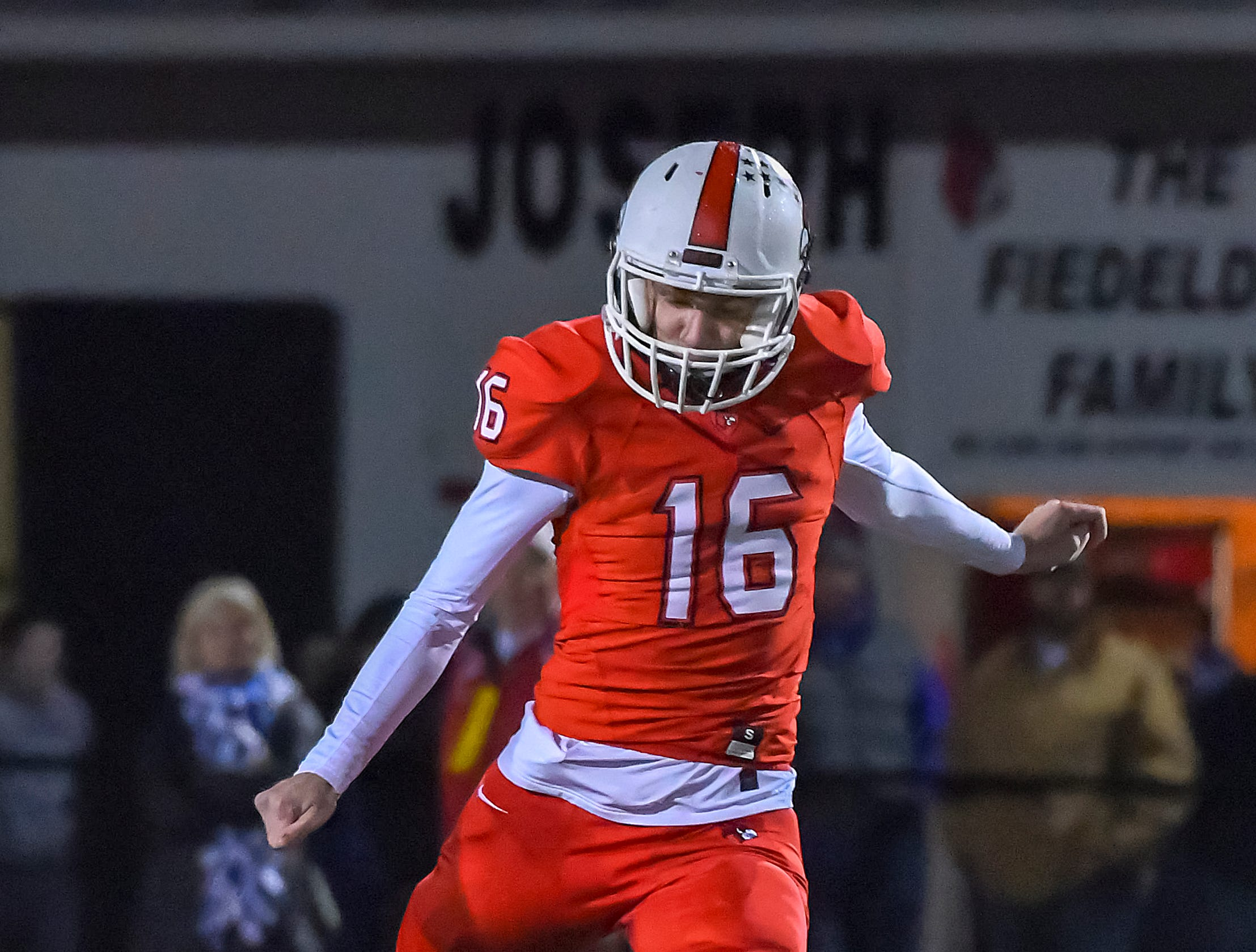 Colerain kicker Chris Mangold kicks off to the Bombers in the OHSAA DI Region 4 Playoffs at Colerain High School,  Friday Nov. 2, 2018