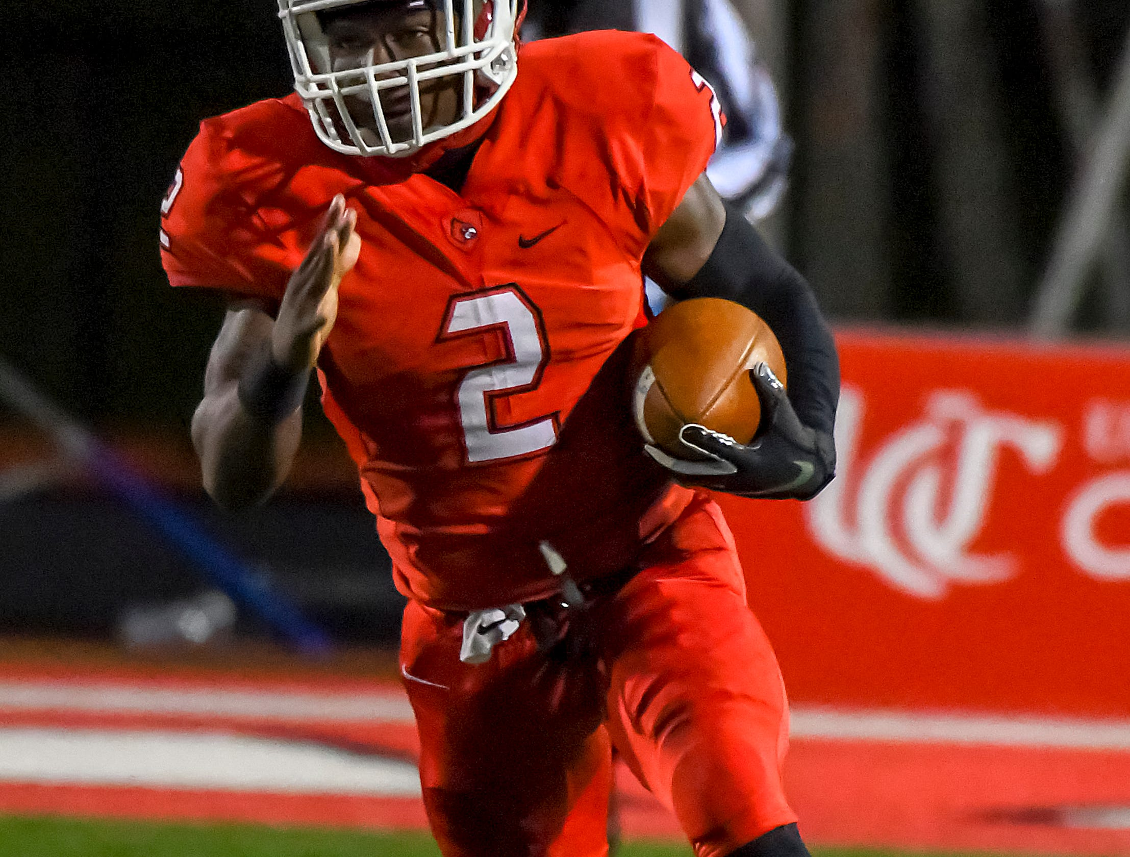 Deante Smith-Moore of Colerain runs the football for a touchdown against St. X in the OHSAA DI Region 4 Playoffs at Colerain High School,  Friday Nov. 2, 2018