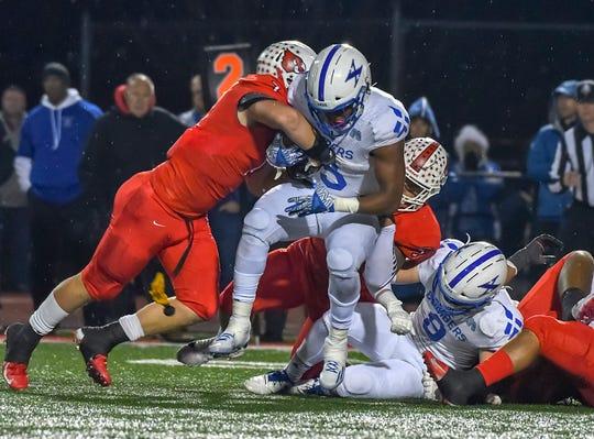 Colerain linebacker Luke Bolden (7) tackles Chris Payne (3) of St. X in the OHSAA DI Region 4 Playoffs at Colerain High School,  Friday Nov. 2, 2018