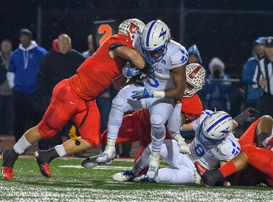 Colerain linebacker Luke Bolden (7) tackles Chris Payne (3) of St. X in the OHSAA DI Region 4 Playoffs at Colerain High School,  Friday Nov. 2, 2018