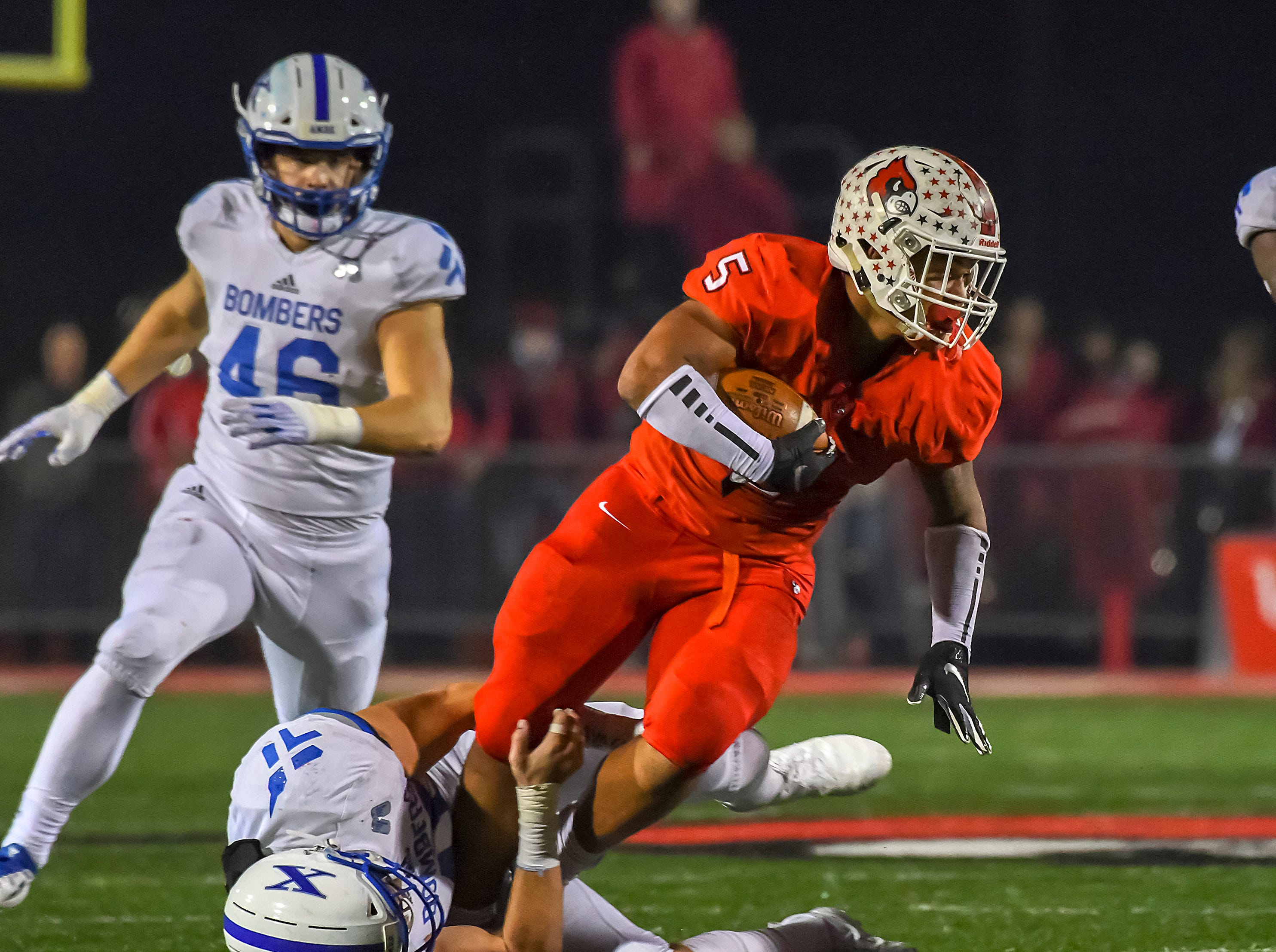 Ivan Pace Jr. of Colerain runs the ball against St. X in the OHSAA DI Region 4 Playoffs at Colerain High School,  Friday Nov. 2, 2018
