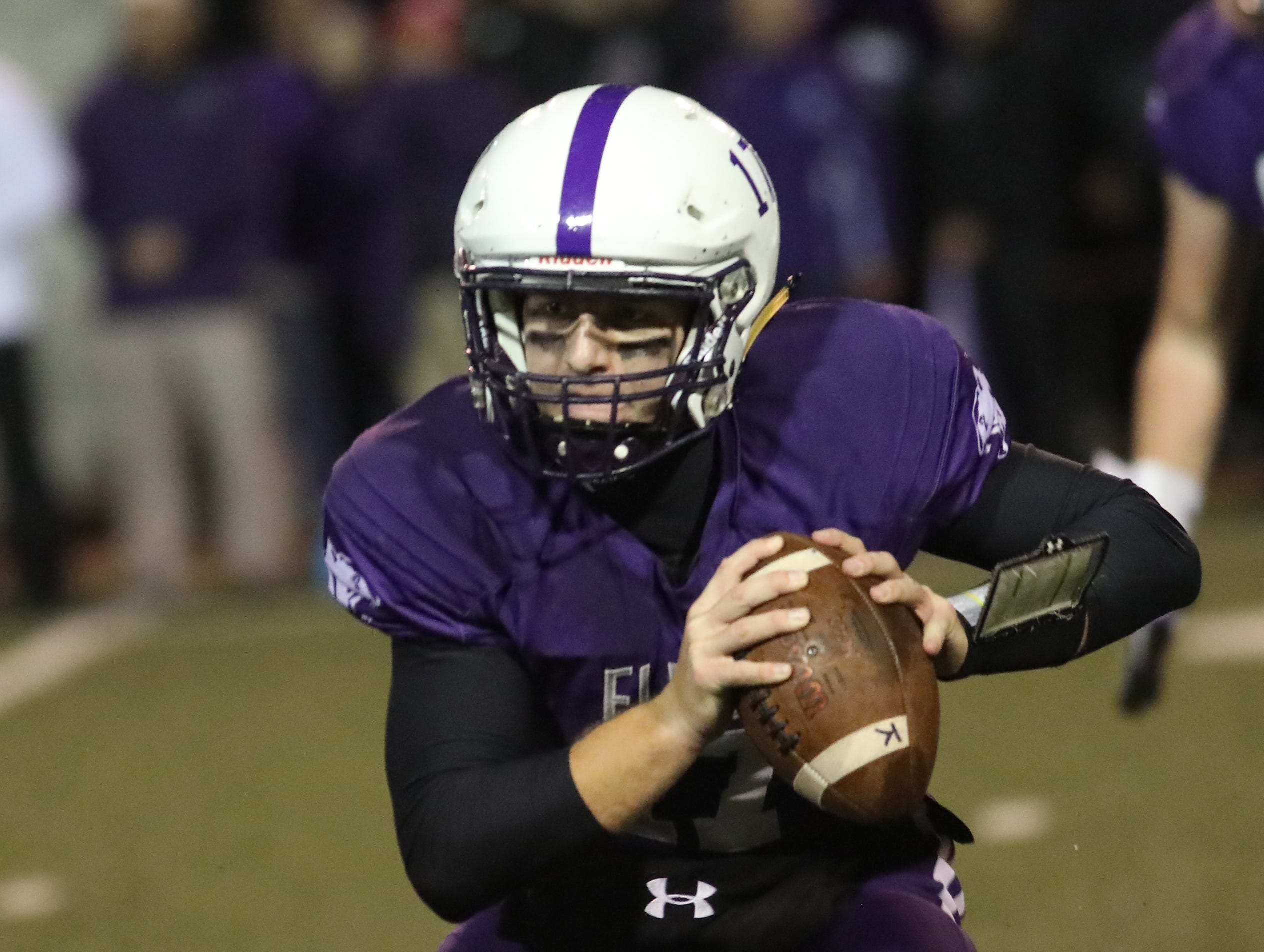 Elder quarterback  Micheal Bittner runs the ball during the Panthers' playoff game against Moeller, Friday, Nov. 2, 2018.