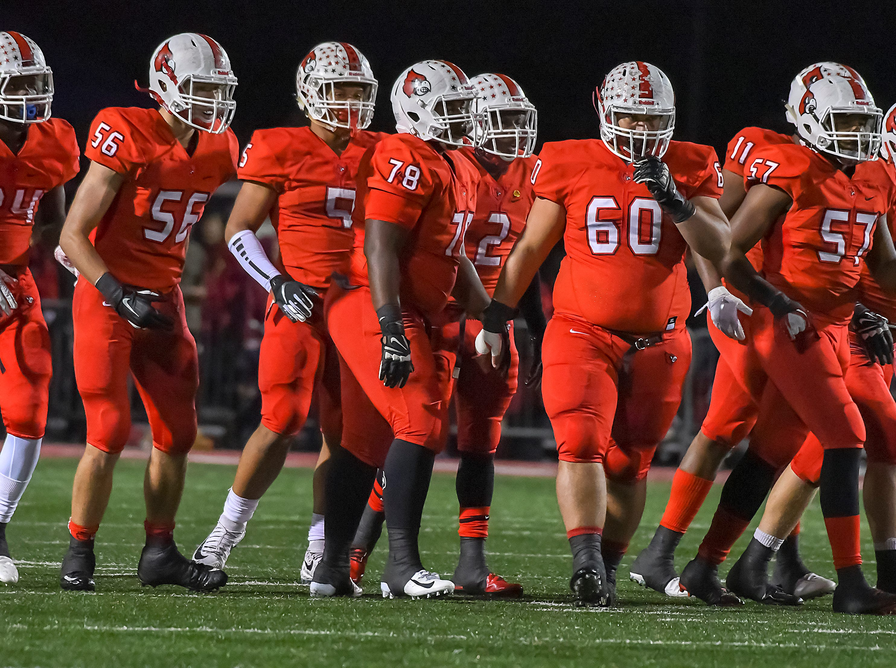 The Cardinal offense breaks the huddle in the OHSAA DI Region 4 Playoffs at Colerain High School,  Friday Nov. 2, 2018