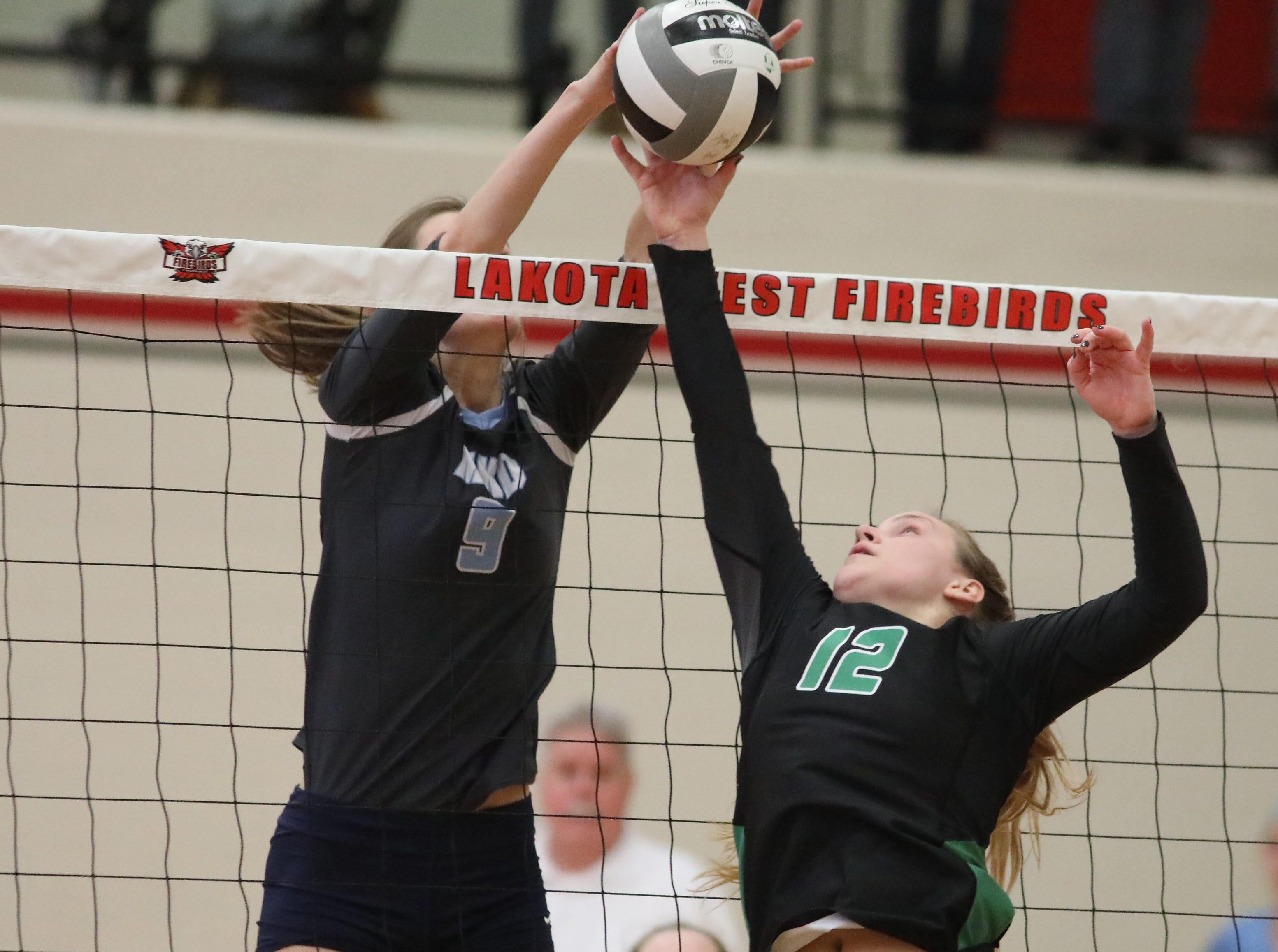 Mount Notre Dame player Carly Hendrickson (2) battles Ursuline Academy player Julia Wilkins during their regional final match, Saturday, Nov. 3, 2018.
