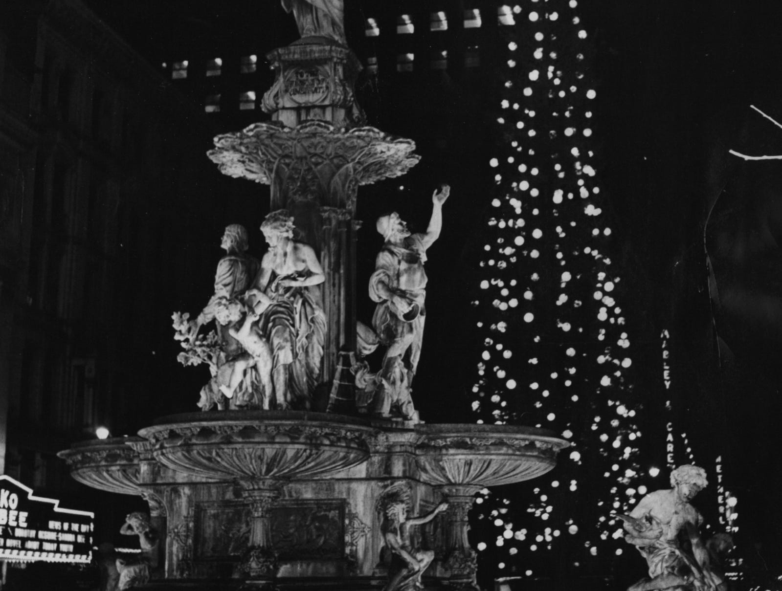 1959: A flick of a switch brought the fall color and warmth of the Christmas season to Fountain Square as lights on two 100-foot Christmas trees were lit in a simple ceremony.