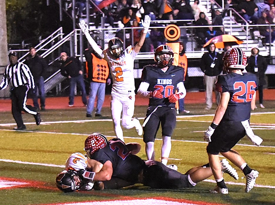 Cooper Bushman (3) lands in the end zone for an Anderson touchdown after a long Redskins pass and catch, Nov. 2, 2018.
